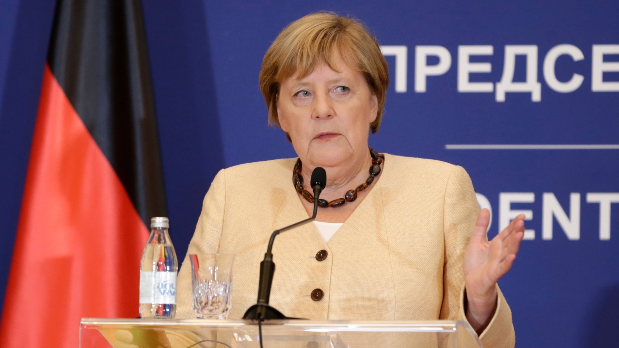 epa09466043 German Chancellor Angela Merkel talks during the press conference with Serbian President Aleksandar Vucic (not pictured) after their meeting in Belgrade, Serbia, 13 September 2021. Chancellor Merkel is on an official state visit to Serbia.  EPA/ANDREJ CUKIC