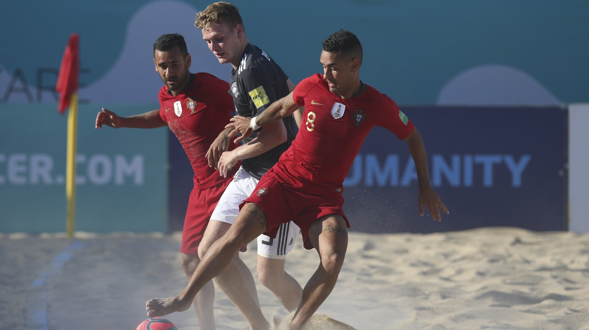 The players of the Portuguese national team, Leo Martins (L) and Be Martins (R), fights for the ball with Paul Baaske of the German national team during the Superfinal of the European Beach Soccer League held at Nazare, Portugal, 3 September 2020. PAULO CUNHA/LUSA