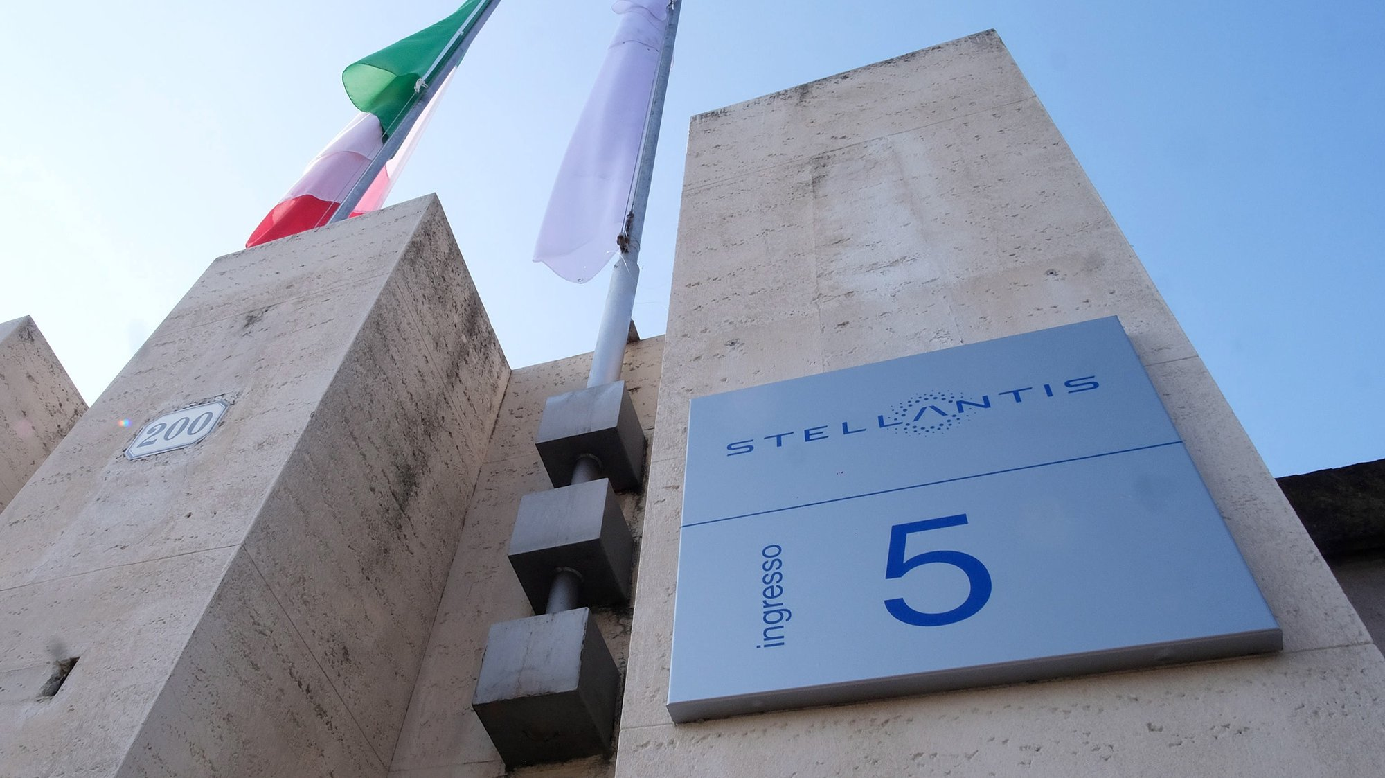 """epa08943875 The """"Stellantis"""" sign posted at the main entrance of the Fiat Mirafiori building in Turin, Italy, 17 January 2021. Fiat-Chrysler (FCA) and Groupe PSA sealed a 38 billion US dollar merger on 16 January 2021 to create Stellantis, the world's fourth-largest auto group.  EPA/ALESSANDRO DI MARCO"""