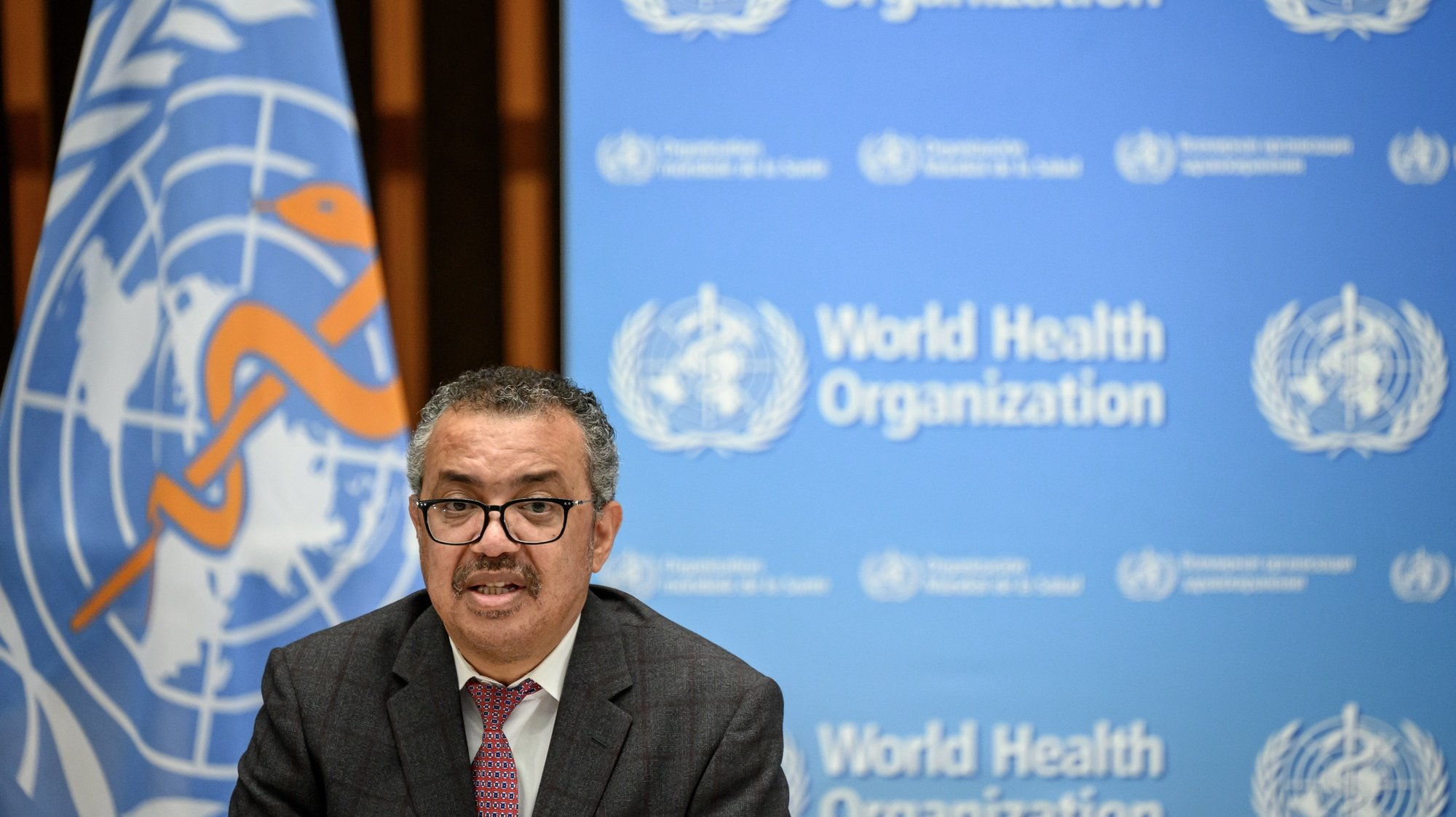 epa09529944 World Health Organization (WHO) Director-General Tedros Adhanom Ghebreyesus delivers a speech during the launch of a multiyear partnership with Qatar on making the FIFA Football World Cup 2022 and mega sporting events healthy and safe, at the WHO headquarters in Geneva, Switzerland,  18 October 2021.  EPA/FABRICE COFFRINI / POOL