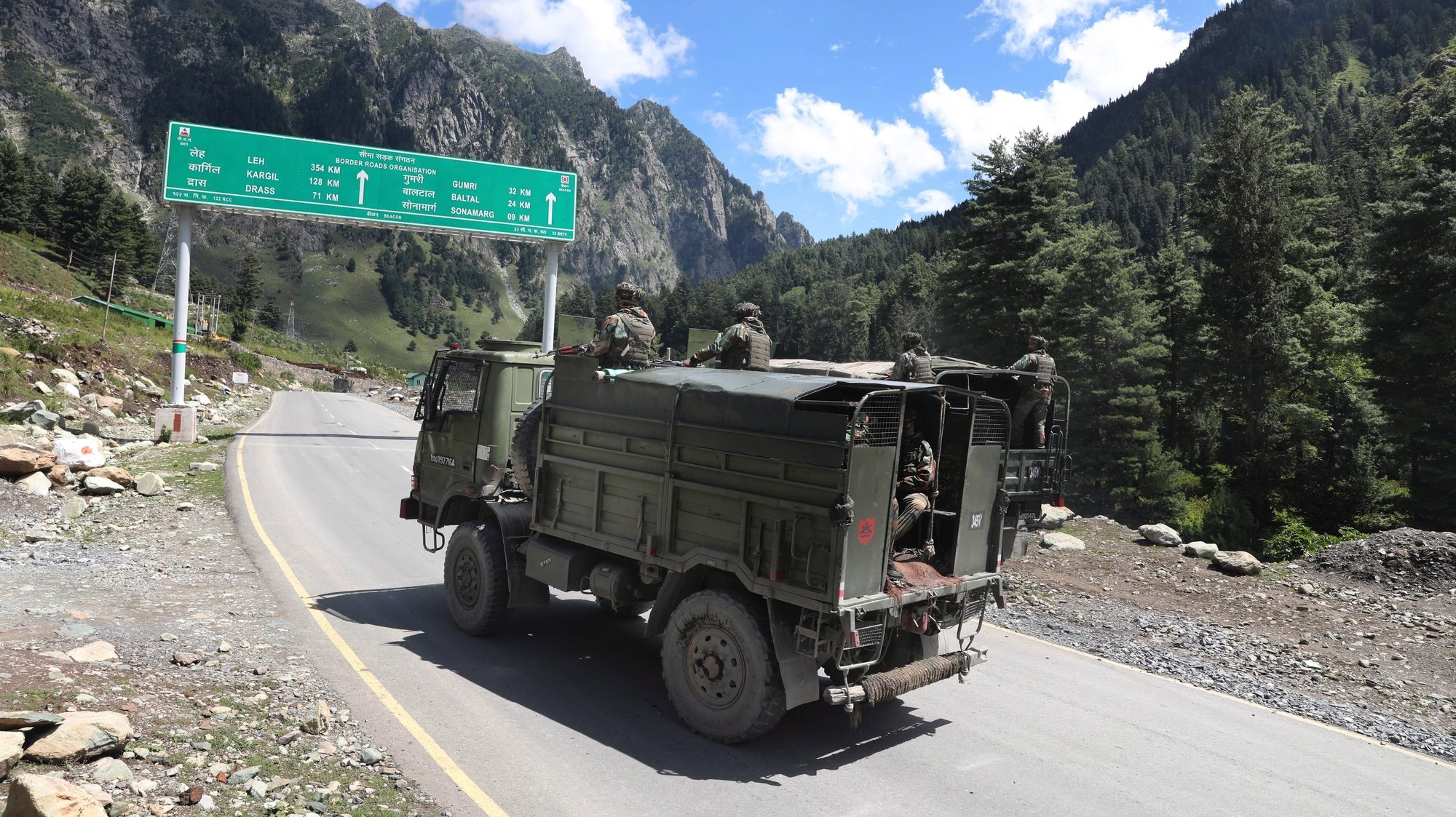 epa08658802 Indian army vehicles move along a highway leading to Ladakh, at Gagangeer some 81 kilometers from Srinagar, the summer capital of Indian Kashmir, 07 September 2020 (issued 10 September 2020). Apart from nomadic families with goats, sheep and horses, no one is allowed to travel along the normally bustling mountain road to allow the Indian military to operate freely amid a months-long standoff between India and China along the disputed border in eastern Ladakh.  EPA/FAROOQ KHAN