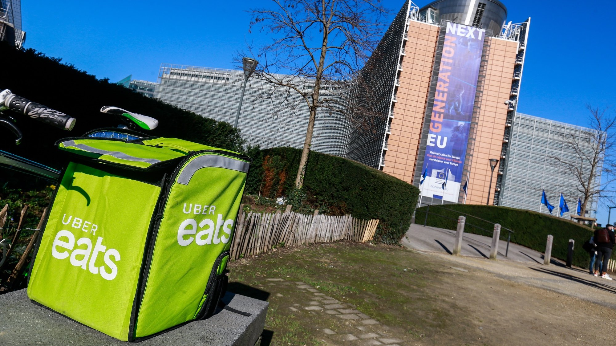 epa09033370 An Uber eats delivery box during the gathering of different trade union organizations for the International Platform Workers Action Day in front of the European Commission in Brussels, Belgium, 24 February 2021. The European Commission begins a consultation on 24 February in its initiative to help improve the working conditions of Platform workers. The trade unions and the Belgian courier collective call on the Commission to go in the direction of the demands and the interests of the workers, not of the platforms. The same type of action takes place in 15 different countries on the same day.  EPA/STEPHANIE LECOCQ