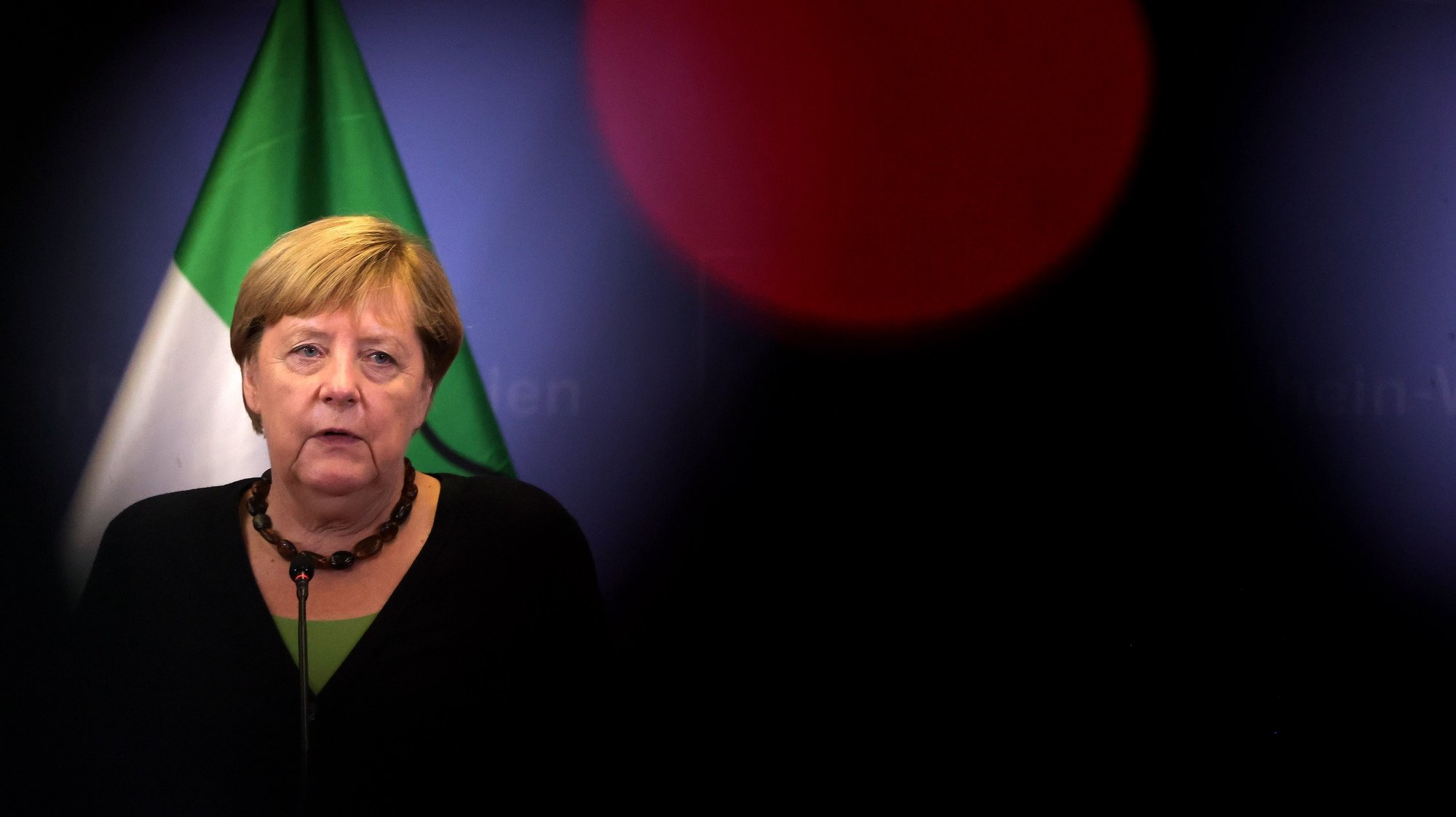 epa09449458 German Chancellor Angela Merkel attends a press conference after visit flood-affected regions in North Rhine-Westphalia in Hagen, Germany, 05 September 2021. Large parts of western Germany and central Europe were hit by flash floods in the night of 14 to 15 July, following days of continuous rain that destroyed buildings and swept away cars. Laschet is the top candidate for chancellor of the Christian Democratic Union (CDU) party in the upcoming September 2021 federal election.  EPA/FRIEDEMANN VOGEL