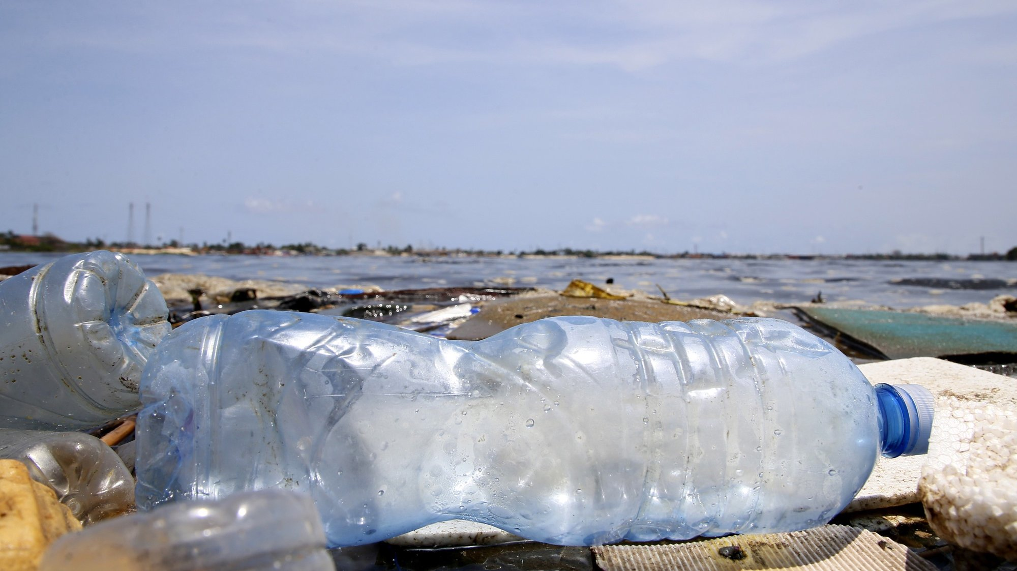 epa09150033 Plastic bottles float on the Ebrie lagoon in the city of Abidjan, Ivory Coast, 21 April 2021. According to the Ivorian Anti Pollution Center (CIAPOL), every day 200 tonnes of solid waste is poured into all of the 8 lagoon bays of Abidjan. This waste is mainly composed of plastics, which have affected the Ebrie lagoon for several decades. This pollution is widespread and will affect environments for hundreds of years. A project has therefore been set up by the Ivorian Antipollution Center (Ciapol) to recover its plastic waste from the water bodies and bring it back to land in order to send it to a treatment or recycling circuit.  EPA/LEGNAN KOULA