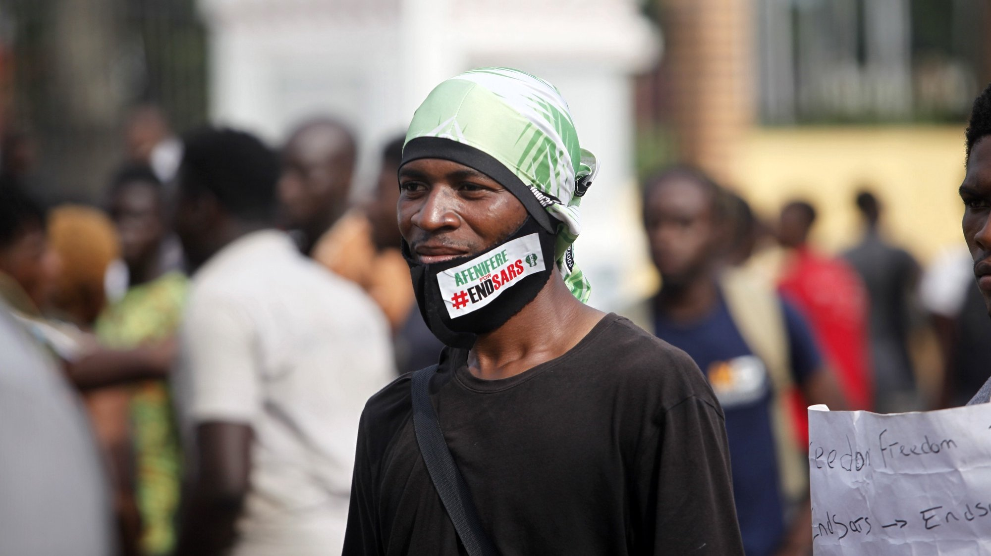epa08760289 A protester wears a facemask with the inscription 'ENDSARS' during a protest against the Nigeria rogue police, otherwise know as Special Anti-Robbery Squad (SARS), in Ikeja district of Lagos, Nigeria, 20 October 2020. It has been two weeks since the protests against SARS began and protesters say agitation against police brutality continues as an entry point to addressing other social and political issues such as corruption, official ineptitude to public accountability, and government inefficiency in Nigeria. The Lagos governor has imposed a 24-hour restriction on movement starting at four pm on 20 October in Lagos as protest begins to turn violent.  EPA/AKINTUNDE AKINLEYE