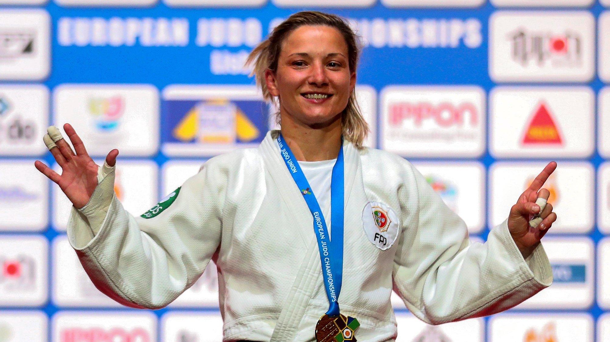 epa09140115 Telma Monteiro of Portugal celebrates on the podium after beating Kaja Kajzer of Slovenia in their gold medal bout of the women's -57kg category at the European Judo Championships in Lisbon, Portugal, 16 April 2021.  EPA/NUNO VEIGA