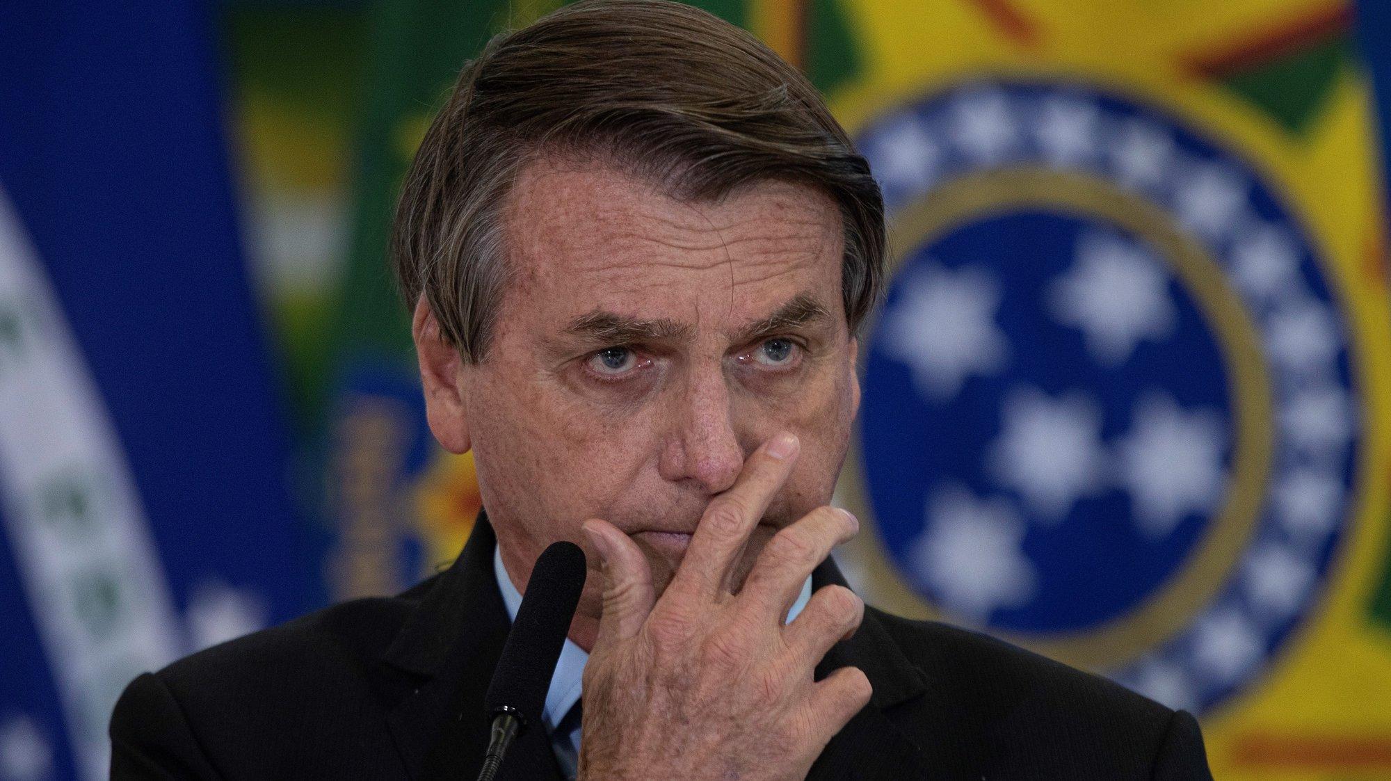 epa09097687 Brazil's president Jair Bolsonaro participates in the announcement of CAIXA's new measures to support Santas Casas and Hospitales Filantropicos, at the Palacio do Planalto in the city of Brasilia, Brazil, 25 March 2021.  EPA/Joedson Alves