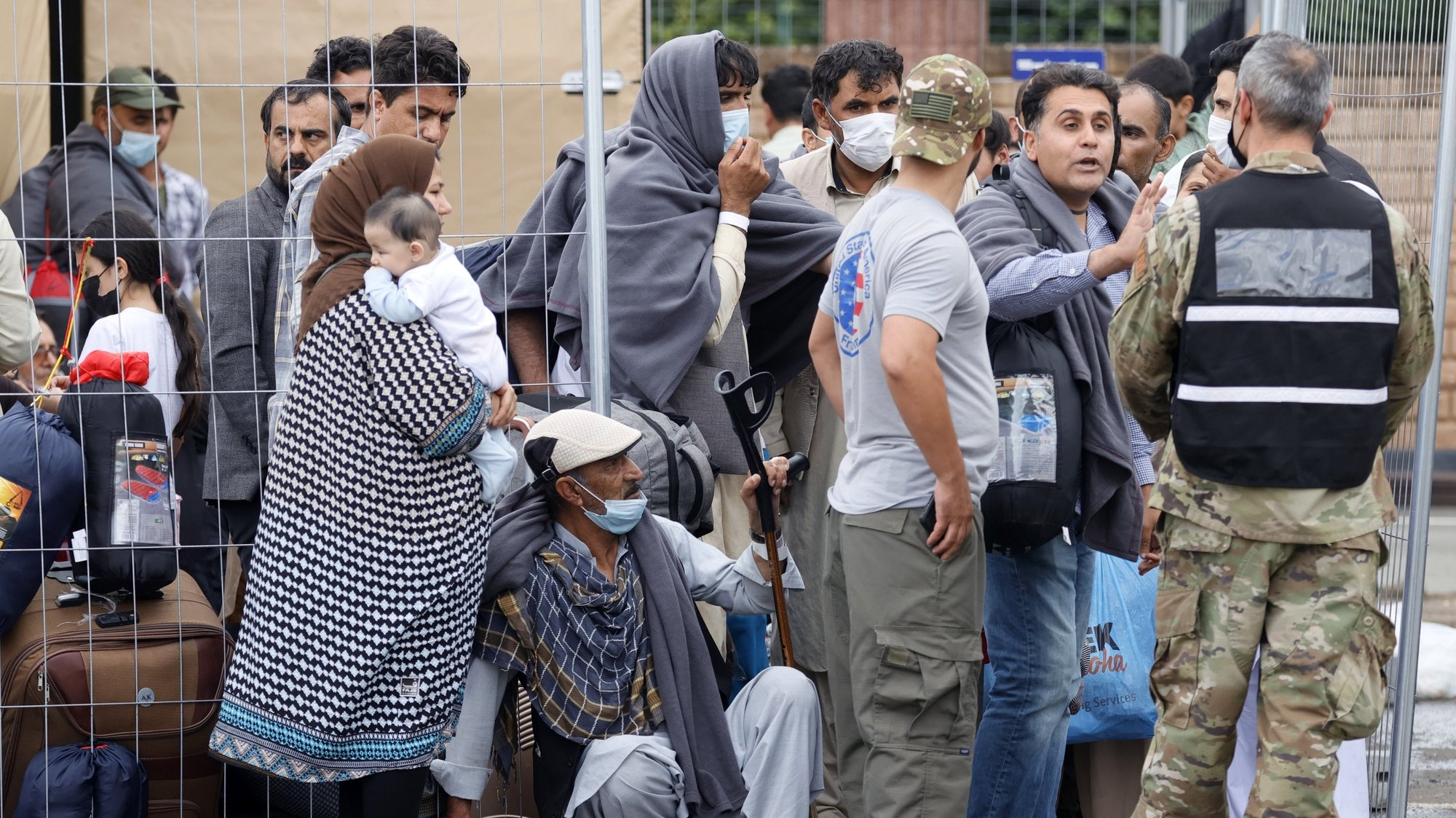epa09436904 Evacuees from Afghanistan wait at the US Air Base in Ramstein, Germany, 30 August 2021. Ramstein Air Base is serving as major hub in the operation to evacuate people from Afghanistan, as the site is the world's largest US air force base outside the United States of America.  As part of Operation Allies Refuge, evacuees will receive support such as temporary lodging, food and water and access to medical care as well as religious care at Ramstein Air Base while preparing for onward movements to their final destinations. This operation is facilitating the quick, safe evacuation of US citizens, Special Immigrant Visa applicants, and other at-risk Afghans from Afghanistan.  EPA/RONALD WITTEK