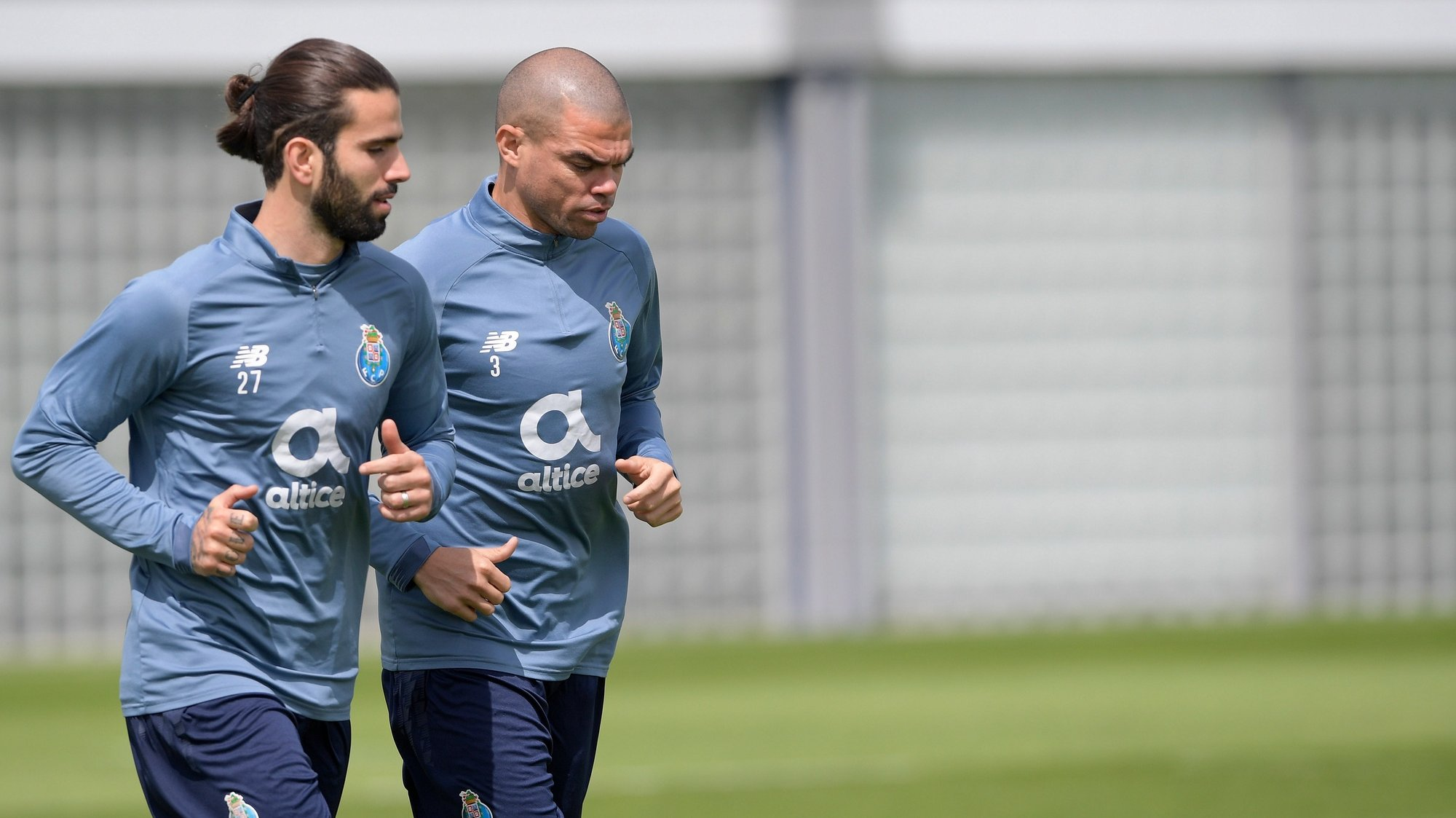 epa09130673 FC Porto's players Sergio Oliveira (L) and Pepe (R) warm up during a trainning session at Olival Trainning Academy in Vila Nova de Gaia,  Portugal, 12 April 2021. FC Porto will face Chelsea in their UEFA Champions League quarterfinal, second leg soccer match at Ramon Sanchez Pizjuan stadium in Seville, Andalusia, Spain, on 13 April 2021.  EPA/FERNANDO VELUDO