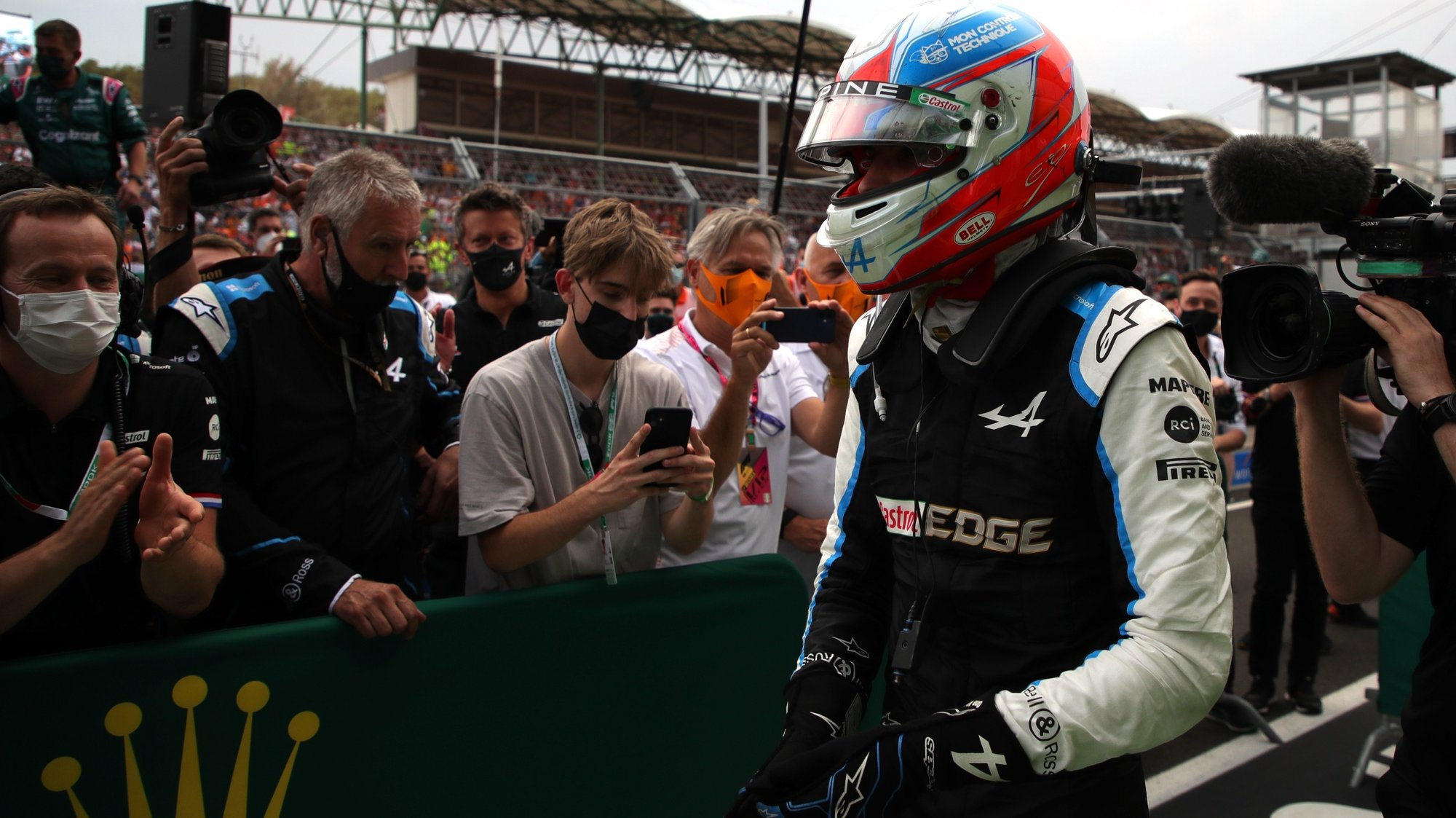 epa09386039 French Formula One driver Esteban Ocon of the Alpine F1 Team reacts after winning the Formula One Grand Prix of Hungary at the Hungaroring circuit in Mogyorod, near Budapest, Hungary, 01 August 2021.  EPA/Florion Goga / POOL