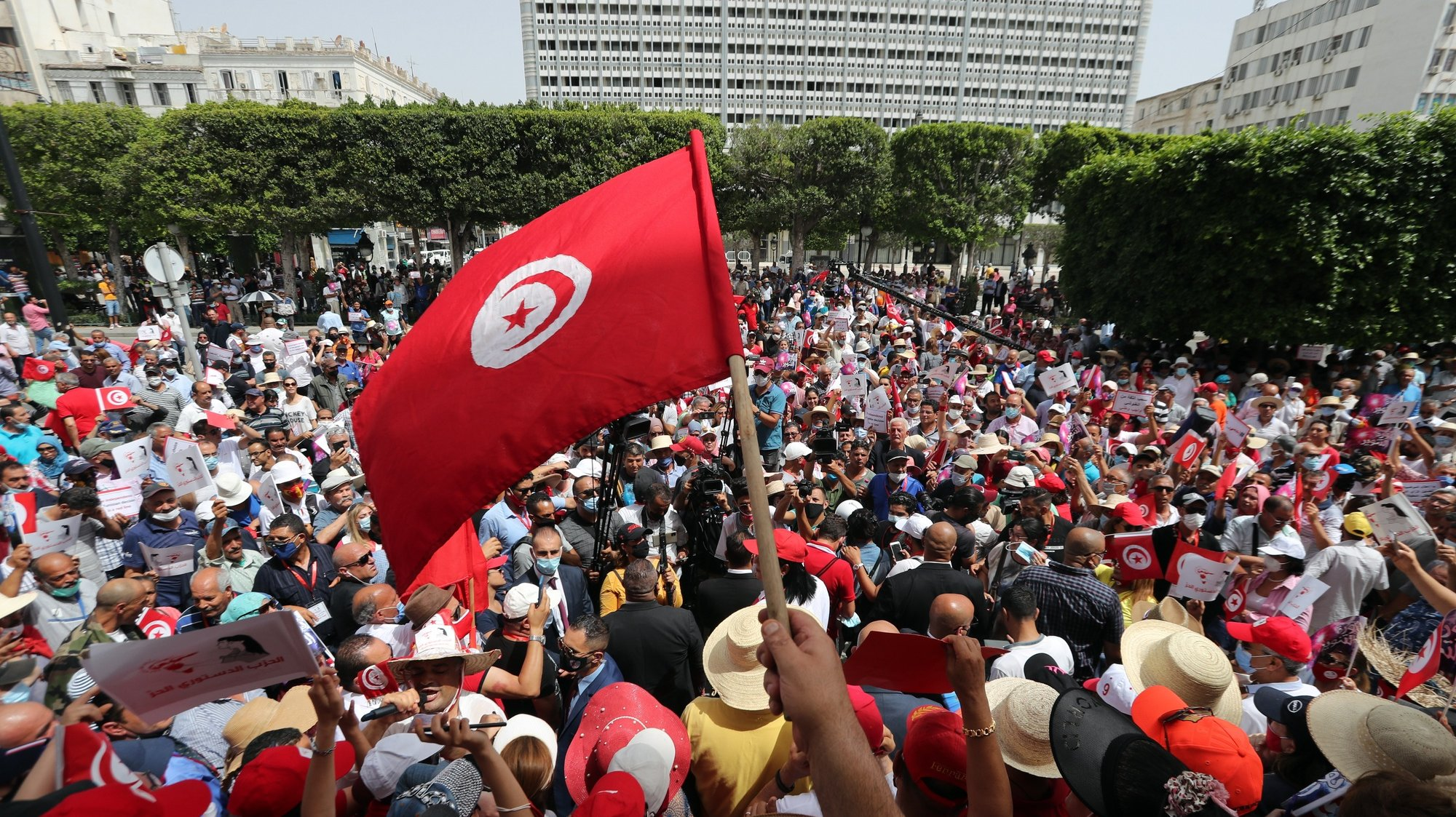 """epa09285695 Supporters of the Free Destourian Party (Free Constitutional Party) shout slogans during protest during a demonstration against political Islamist party Ennahda and the government in Tunis, Tunisia, 19 June 2021. According to the President of the Free Destourian Party, Abir Moussi, """"The national dialogue is useless because the political class is precisely the cause of all the problems. Those who are for the dialogue aim only to artificially prolong the duration of a system which allows them to remain in power where in facade opposition"""".  EPA/MOHAMED MESSARA"""