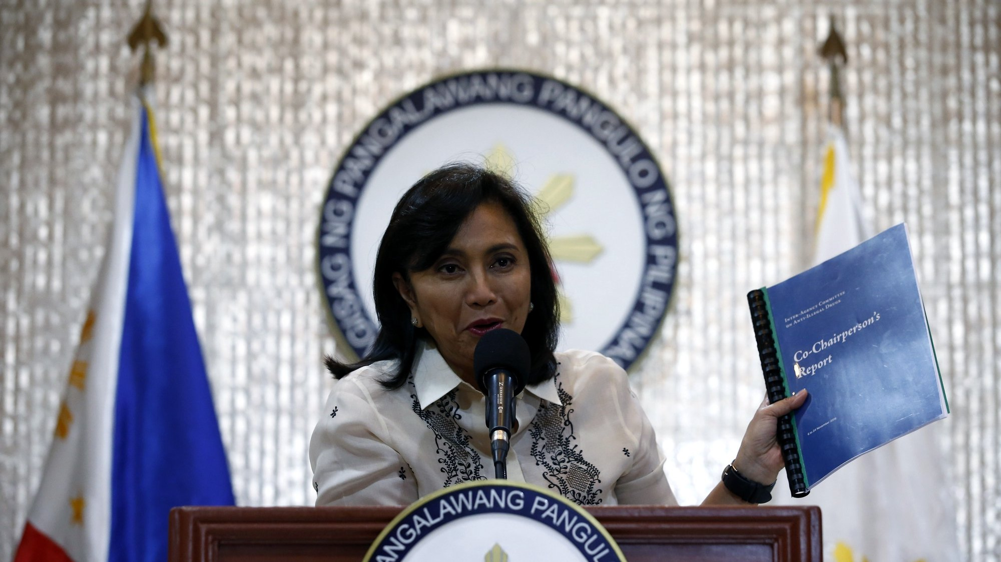 epa08074764 Philippine Vice President Leni Robredo shows a copy of her report, which was compiled from her short stint as co-chair of the country's Inter-Agency Committee on Anti-Illegal Drugs, at a press conference in Quezon City, Philippines, 16 December 2019. Robredo, who was barely a month into the position of co-chair when President Rodrigo Duterte removed her, deferred releasing details of her report on the country's illegal drugs situation and instead called for unity in helping people affected by the 6.9-magnitude earthquake that hit parts of the southern Philippines on 15 December.  EPA/ROLEX DELA PENA