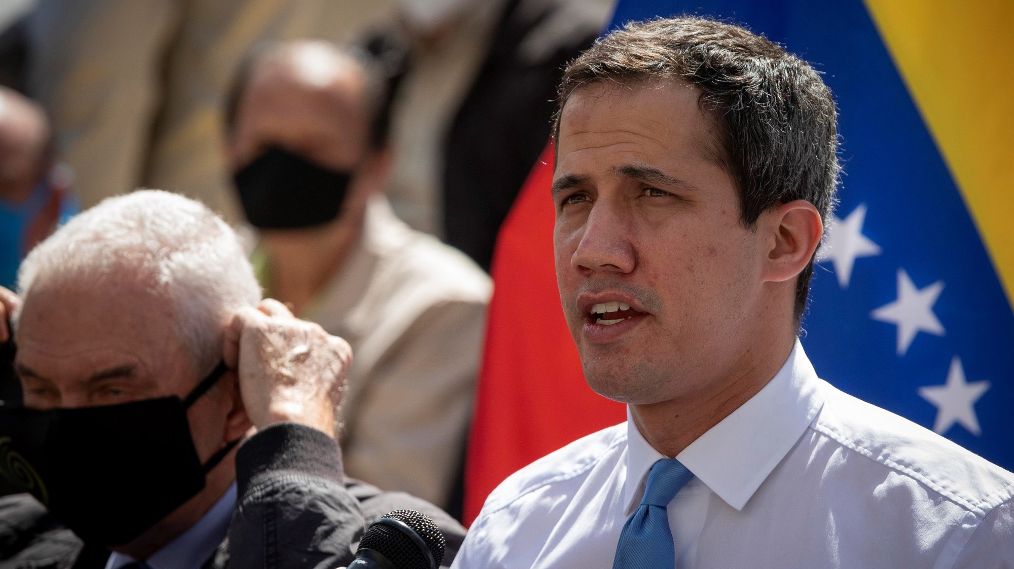 epa08985494 Venezuelan opposition leader Juan Guaido speaks during a press conference in Caracas, Venezuela, 03 February 2021. Guaido said that he is willing to seek resources for Venezuela to enter the COVAX vaccination program against covid-19, but indicated that its implementation depends on the Government of Nicolas Maduro accepting the scheme of the Pan American Health Organization (PAHO). On 20 January 2021, the lawyers of the board of the Central Bank of Venezuela (BCV) appointed by Maduro denounced that Guaido's team prevented access to funds in London that would allow participation in the Covax Mechanism.  EPA/RAYNER PENA R