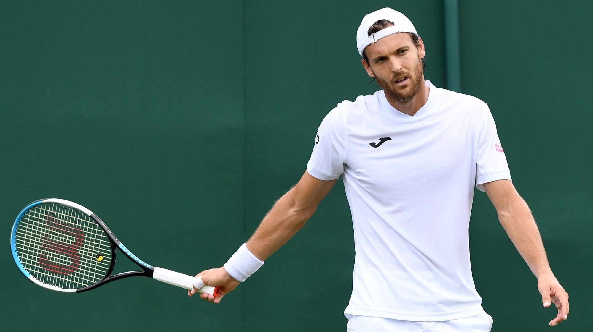epa09308411 Joao Sousa of Portugal reacts during the 1st round match against Andreas Seppi of Italy  at the Wimbledon Championships, Wimbledon, Britain 28 June 2021.  EPA/FACUNDO ARRIZABALAGA
