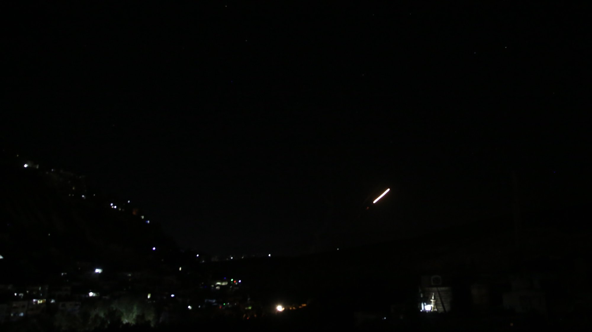 epa09444317 Syrian air defenses intercept projectiles allegedly launched from Israel, in the countryside near Damascus, Syria, 02 September 2021. According to SANA, the air defences downed a number of missiles in the skies above Damascus.  EPA/YOUSSEF BADAWI