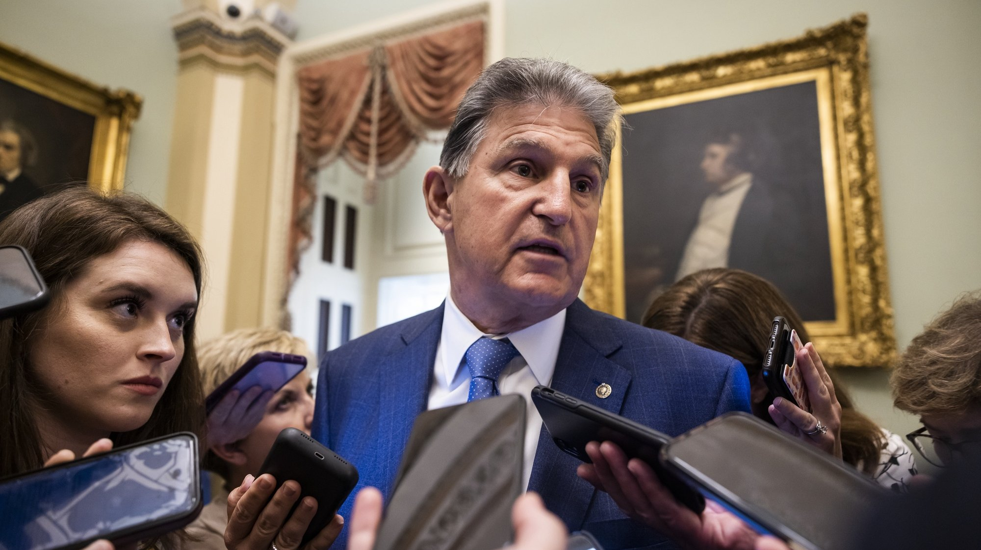 epa09344690 Democratic Senator from West Virginia Joe Manchin speaks to reporters after US President Joe Biden met with lawmakers seeking their support for his two-bill approach to infrastructure spending in the US Capitol in Washington, DC, USA, 14 July 2021.  EPA/JIM LO SCALZO