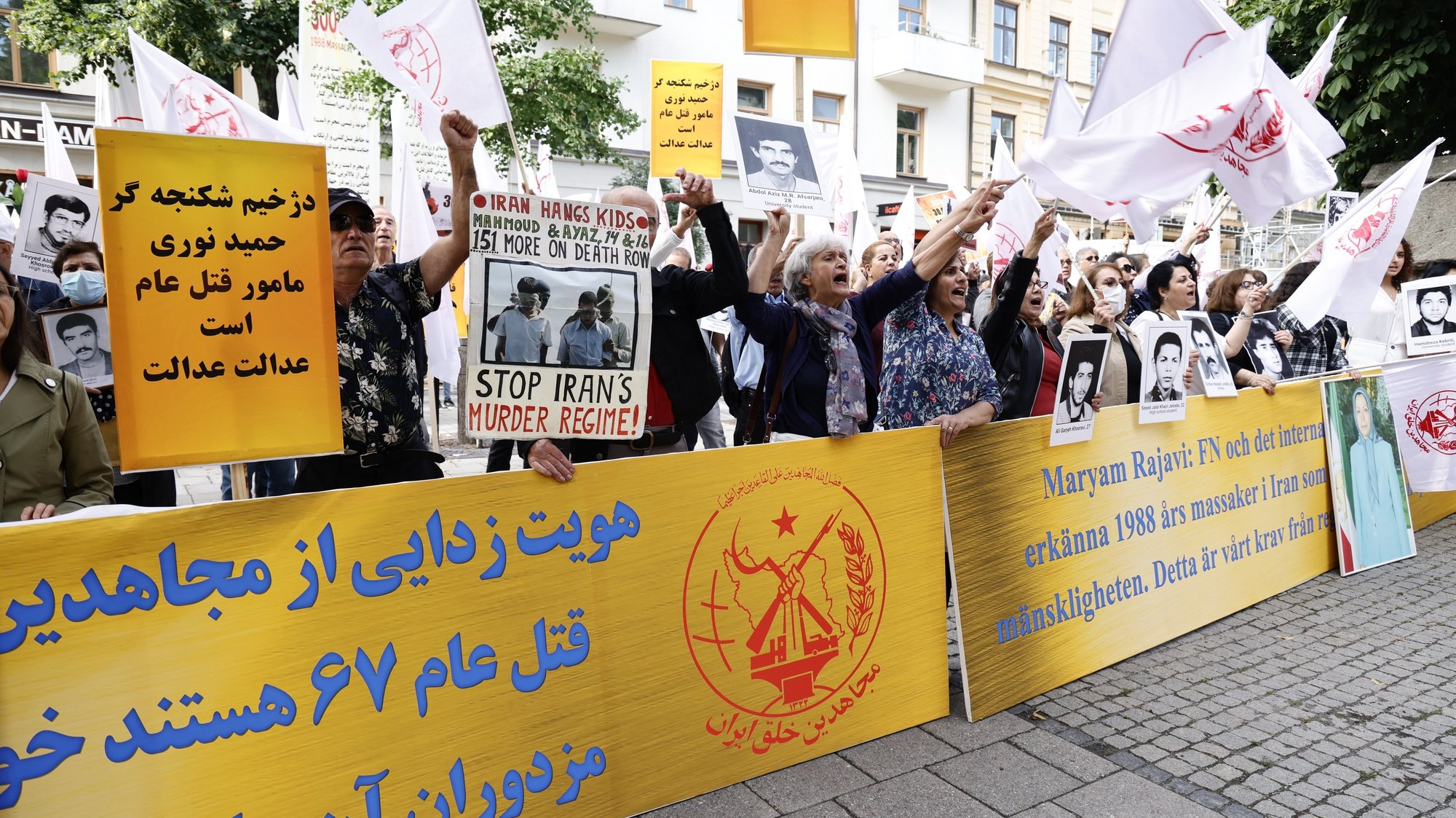 epa09407908 Supporters of the People's Mojahedin Organization of Iran protestoutside Stockholm distric court as the trial of Hamid Noury starts in Stockholm, Sweden, 10 August 2021. This is the first day of the trial of Hamid Noury who is accused of involvement in the massacre of political prisoners in Iran in 1988.  EPA/STEFAN JERREVANG SWEDEN OUT