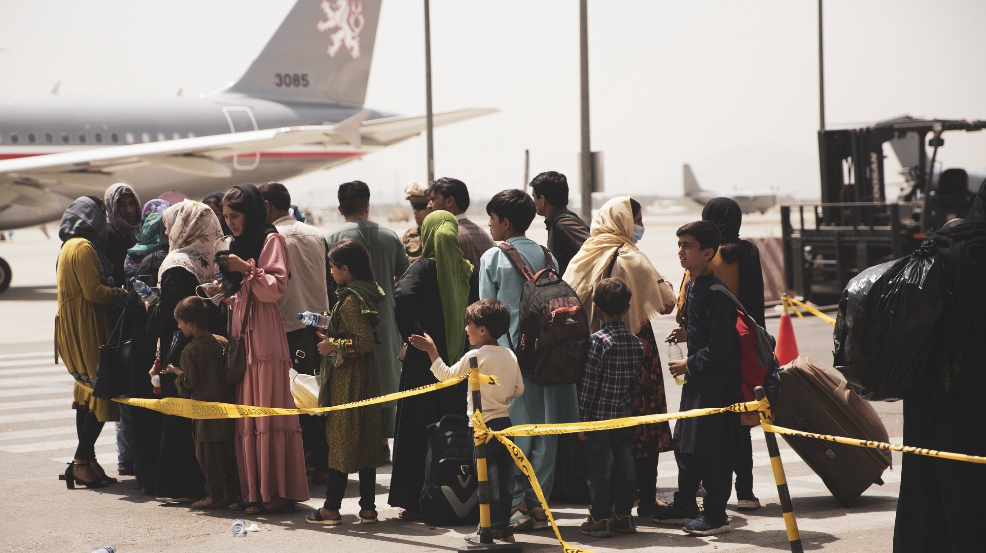 epa09421074 A handout photo made available by US Central Command Public Affairs shows civilians preparing to board a plane during an evacuation at Hamid Karzai International Airport, Kabul, Afghanistan, 18 August 2021 (issued 19 August 2021). US Marines are assisting the Department of State with an orderly drawdown of designated personnel in Afghanistan. (U.S. Marine Corps photo by Staff Sgt. Victor Mancilla) EPA/Staff Sgt. Victor Mancilla/ US Central Command Public Affairs HO Released By:LT Robert MookPublic Affairs OfficerJoint Task Force-Crisis Responserobert.e.mook2.mil@mail.mil HANDOUT EDITORIAL USE ONLY/NO SALES