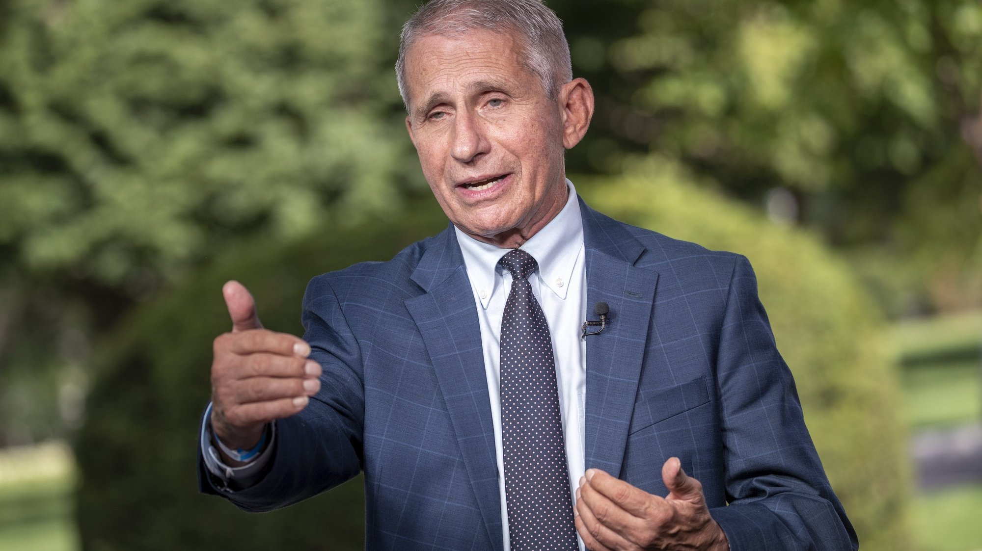 epa09419588 Anthony Fauci, director of the US National Institute of Allergy and Infectious Diseases (NIAID) participates in a television interview at the White House in Washington, DC, USA, 18 August 2021. President Biden said top federal health officials recommend that all Americans get a booster shot eight months after becoming fully vaccinated against COVID-19.  EPA/SHAWN THEW
