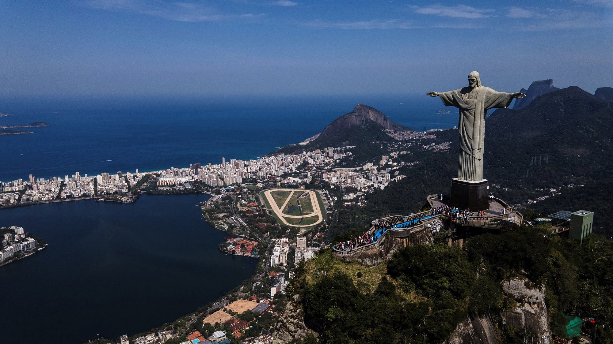 epa08605961 An aerial view of the Christ the Redeemer during its reopening to tourism, in Rio de Janeiro, Brazil, 15 August 2020. Rio de Janeiro has reopened touristic hotspots as the Sugarloaf Mountain, the aquarium, and the giant waterwheel despite warnings for the increase of coronavirus spread in the city.  EPA/Antonio Lacerda