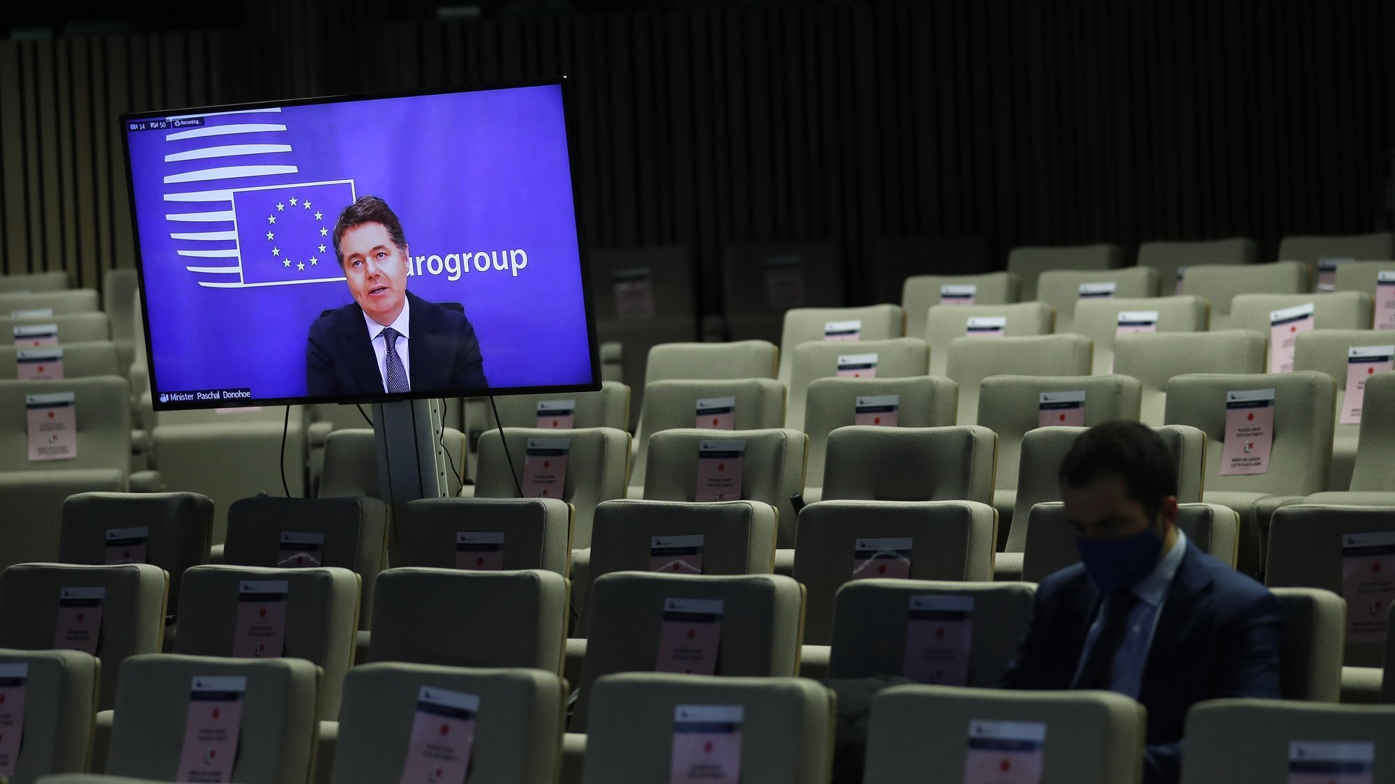 epa08853715 Eurogroup president Paschal Donohoe, on the screen, speaks during an online news conference following an Eurogroup video conference meeting at the European Council headquarters in Brussels, Belgium, 30 November 2020.  EPA/Francisco Seco / POOL
