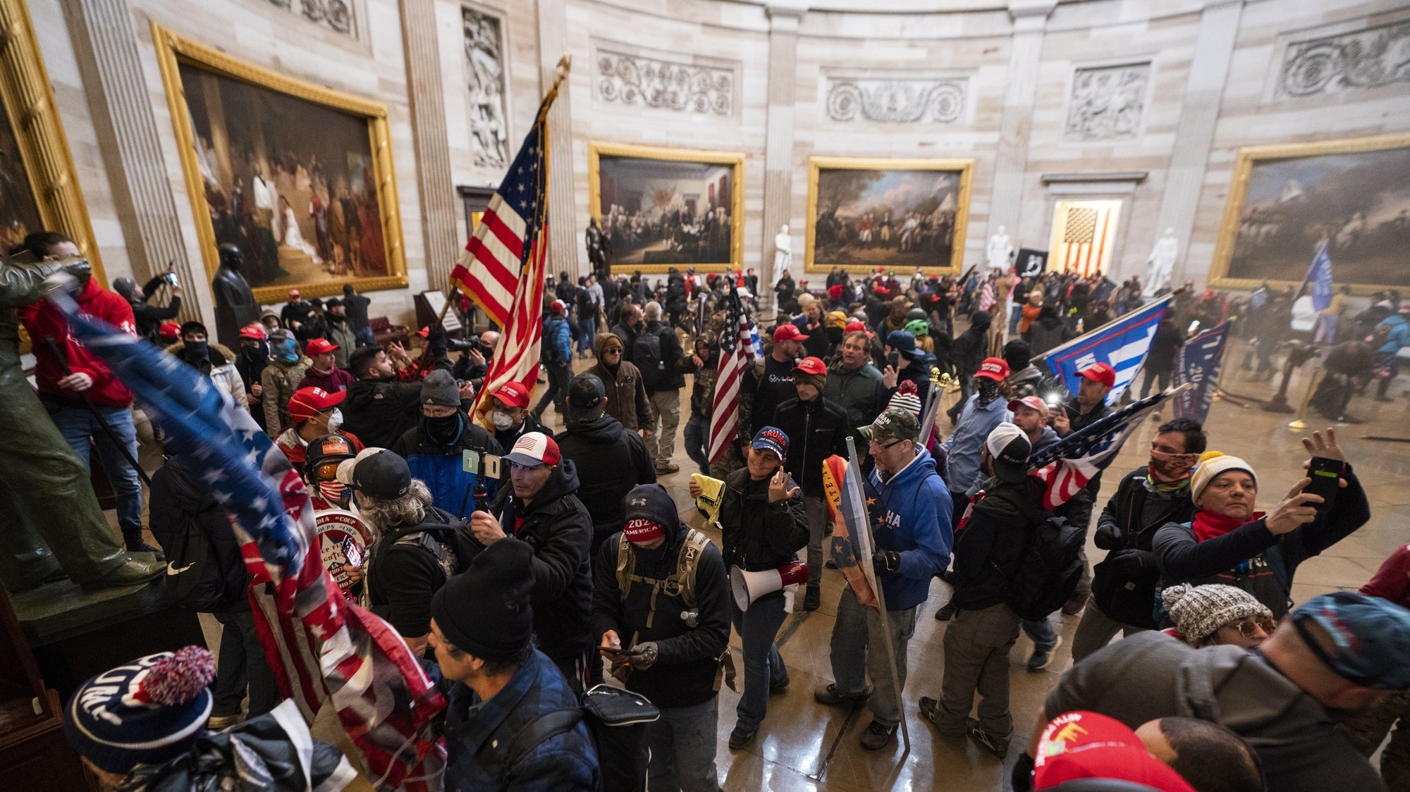 epaselect epa08923423 Supporters of US President Donald J. Trump in the Capitol Rotunda after breaching Capitol security in Washington, DC, USA, 06 January 2021. Protesters entered the US Capitol where the Electoral College vote certification for President-elect Joe Biden took place.  EPA/JIM LO SCALZO