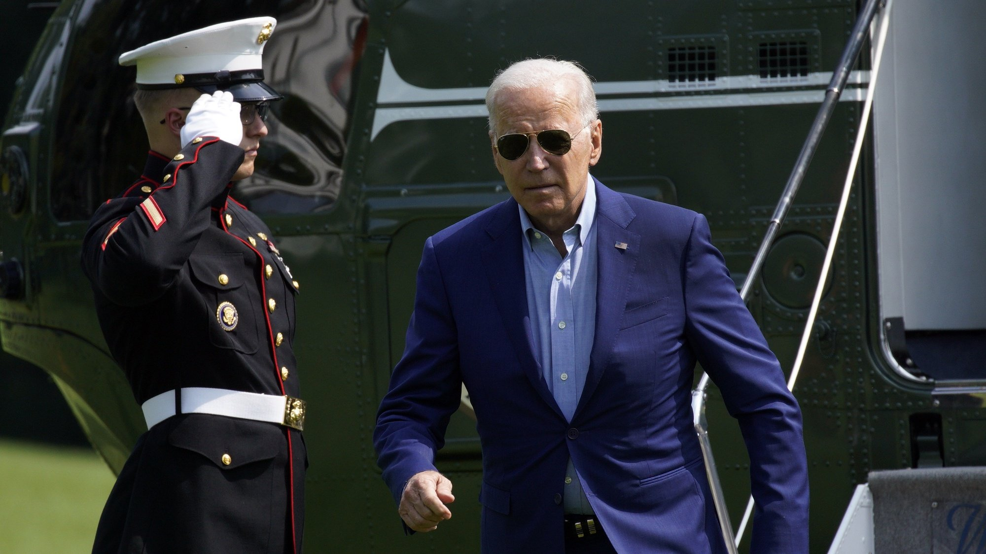 epa09365528 US President Joe Biden walks on the South Lawn of the White House upon his return from Delaware to Washington, DC, USA, 25 July 2021.  EPA/Yuri Gripas / POOL