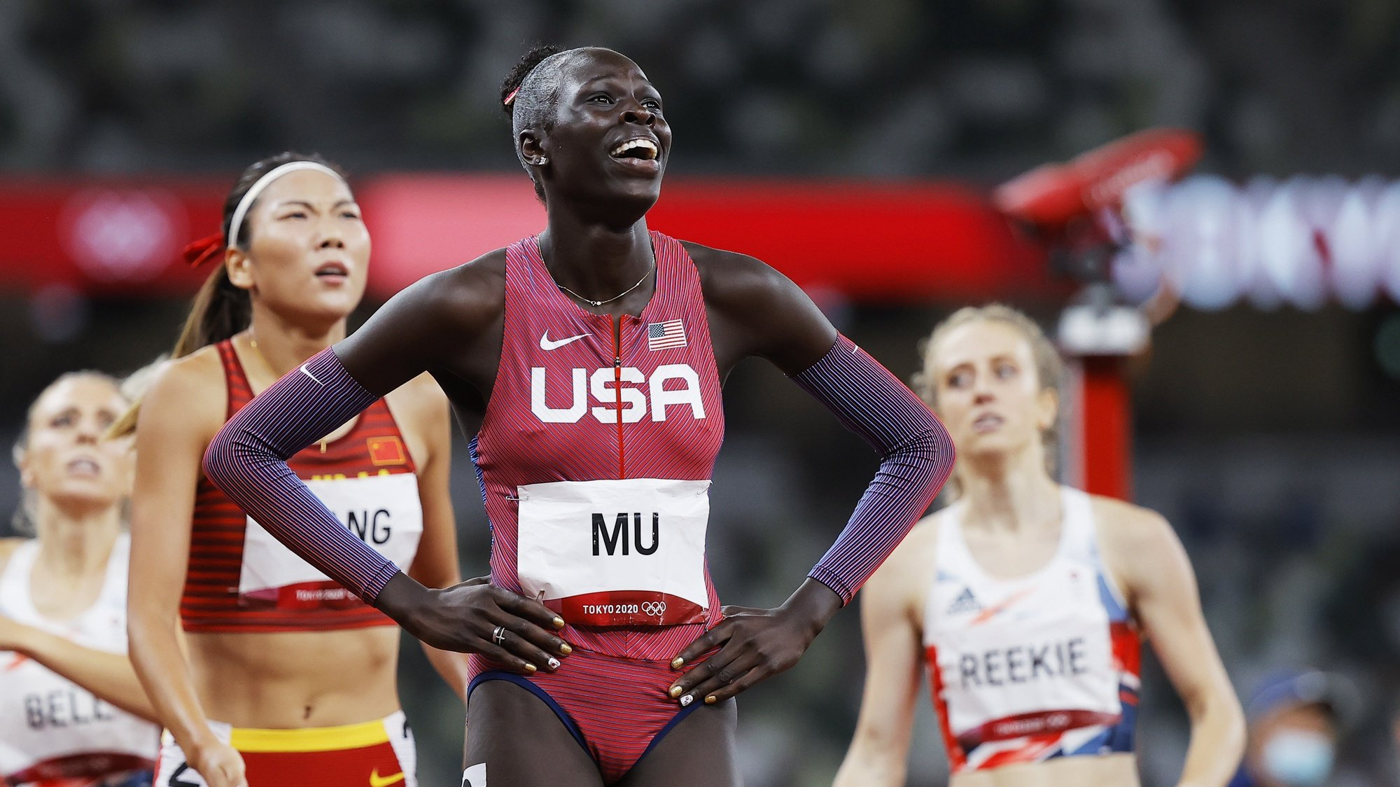 epa09391492 Athing Mu of the US smiles after winning the Women's 800m final at the Athletics events of the Tokyo 2020 Olympic Games at the Olympic Stadium in Tokyo, Japan, 03 August 2021.  EPA/VALDRIN XHEMAJ