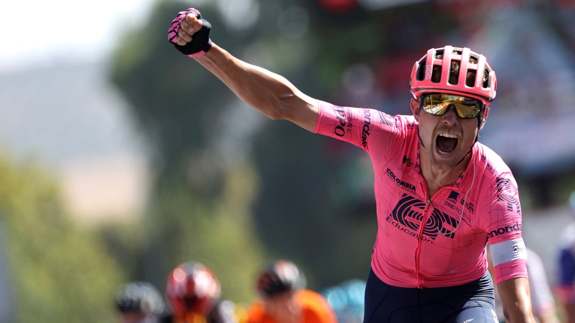 epaselect epa09430583 Danish rider Magnus Cort Nielsen of EF Education team celebrates winning the 12th stage of the Spanish Cycling Vuelta in Jaen, a 175km-long race between Jaen and Cordoba, Spain, 26 August 2021.  EPA/Manuel Bruque
