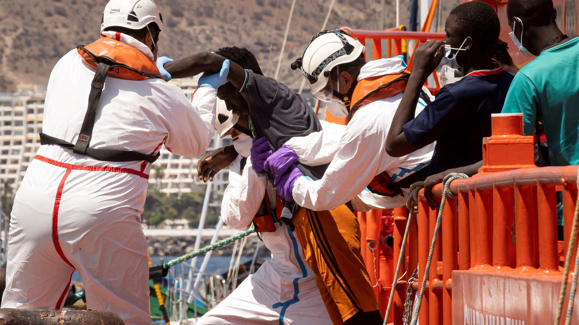 epa09447314 Some of the 56 rescued migrants arrive at the Port in Arguineguin, Gran Canaria, Canary Islands, Spain, 04 September 2021, after being rescued while traveling on a small boat 24 kilometers off the coast of Arguineguin.  EPA/Quique Curbelo