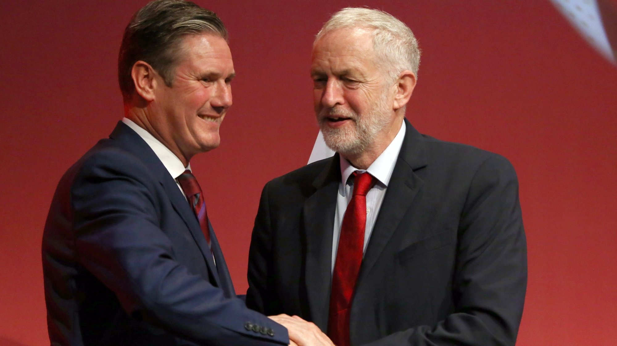 epa08342489 (FILE) - Britain's opposition Labour Party then Spokesperson for Exiting the EU, Keir Starmer (L) is congratulated following his speech by then party leader Jeremy Corbyn (R) at the Labour Party Conference in Brighton, Britain, 25 September 2017 (reissued 04 April 2020). Keir Starmer was announced elected succesor to Labour Party leader Jeremy Corbyn on 04 April 2020 in a ballot of party members, trade unionists and other supporters.  EPA/NEIL HALL *** Local Caption *** 53790919