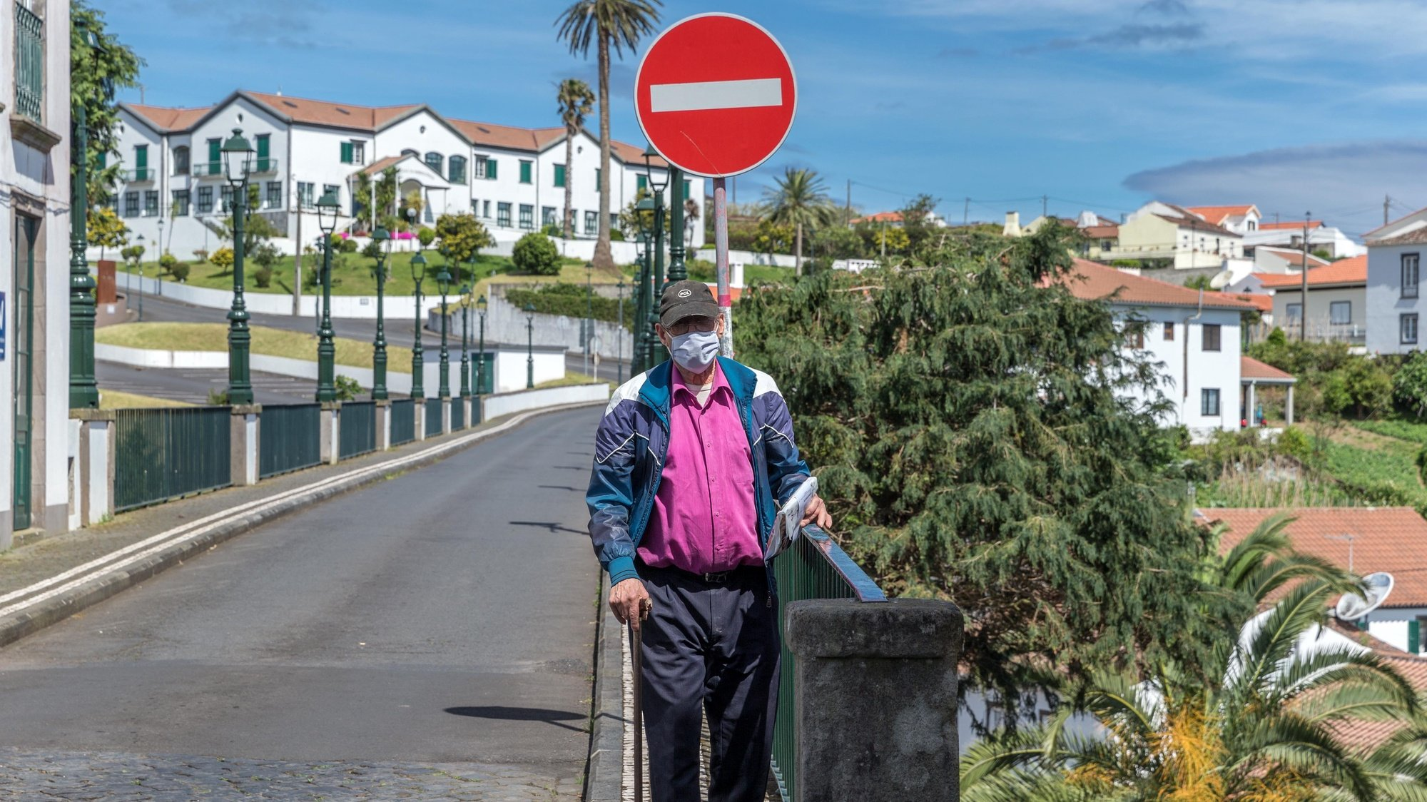 A man protected with a face mask walks on a street in the Nordeste municipality, São Miguel Island, Azores, Portugal, May 18, 2020.  The municipality of Nordeste was the last in the country to leave the sanitary fence because of the covid-19. EDUARDO COSTA /LUSA