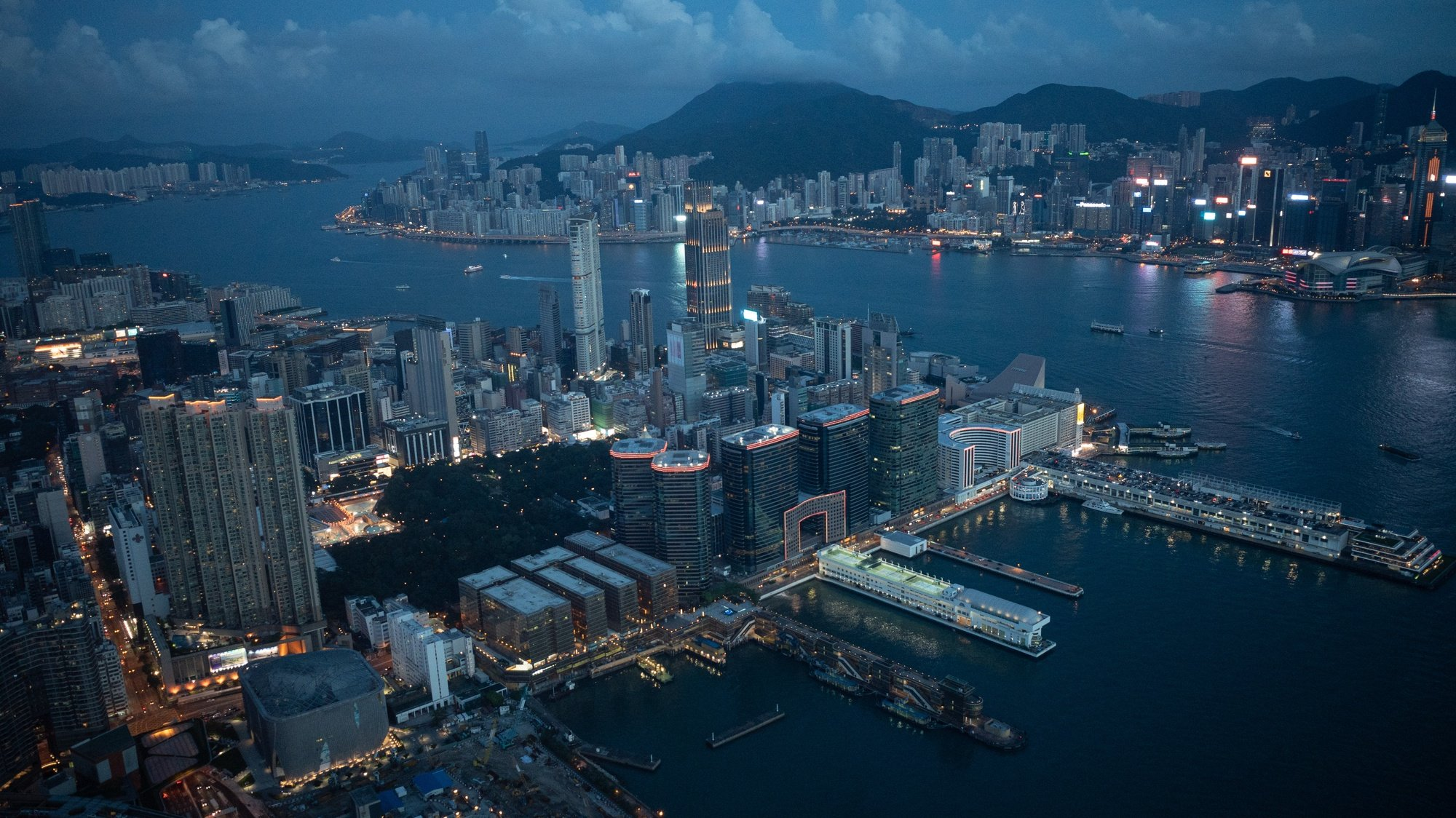epa08683509 Residential and commercial buildings stand on the Kowloon Peninsula (front), and on Hong Kong Island as seen from Sky 100 in Hong Kong, China, 20 September 2020. Sky 100 is located at 393 metres above sea level in the International Financial Centre and offers a 360-degrees panoramic view of the city.  EPA/JEROME FAVRE