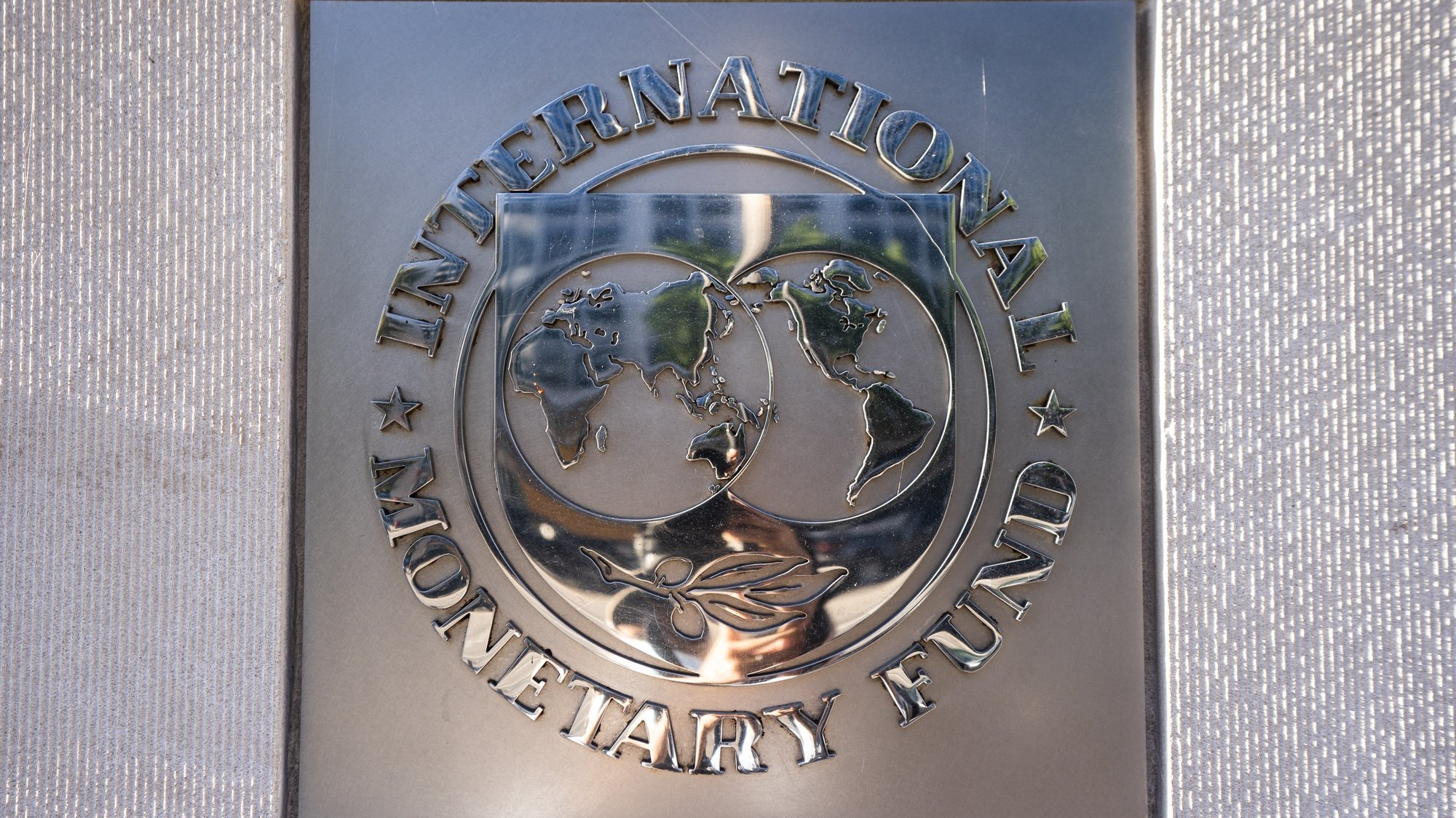 epa08743972 A sign for the International Monetary Fund (IMF) outside its headquarters in Washington, DC, USA, 14 October 2020. The IMF World Bank Group 2020 annual fall meeting has gone virtual due to the Coronavirus pandemic.  EPA/JIM LO SCALZO