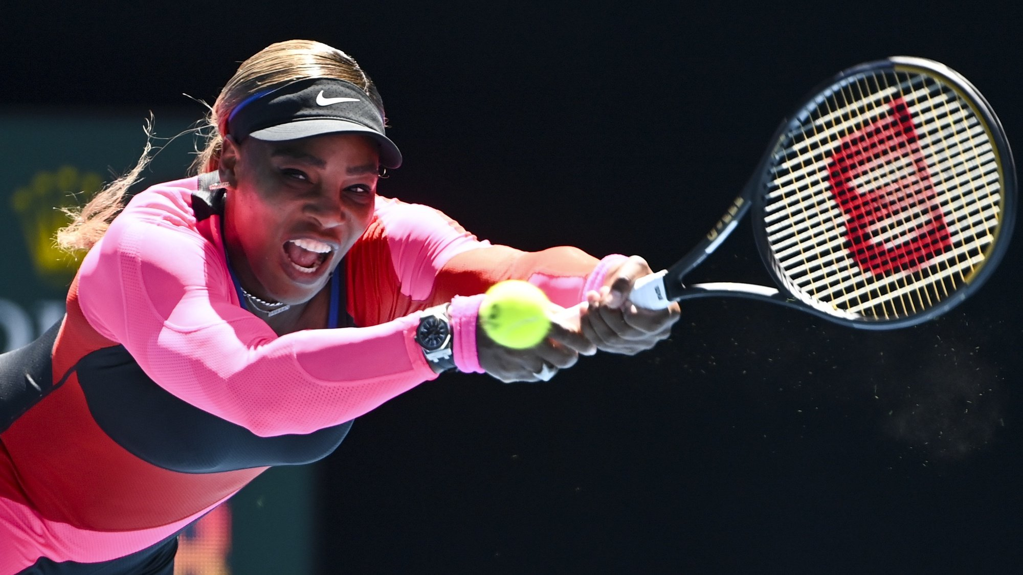 epa09000029 Serena Williams of the United States of America in action against Nina Stojanovic of Serbia during their second round match of the Australian Open Grand Slam tennis tournament in Melbourne, Australia, 10 February 2021.  EPA/DAVE HUNT  AUSTRALIA AND NEW ZEALAND OUT