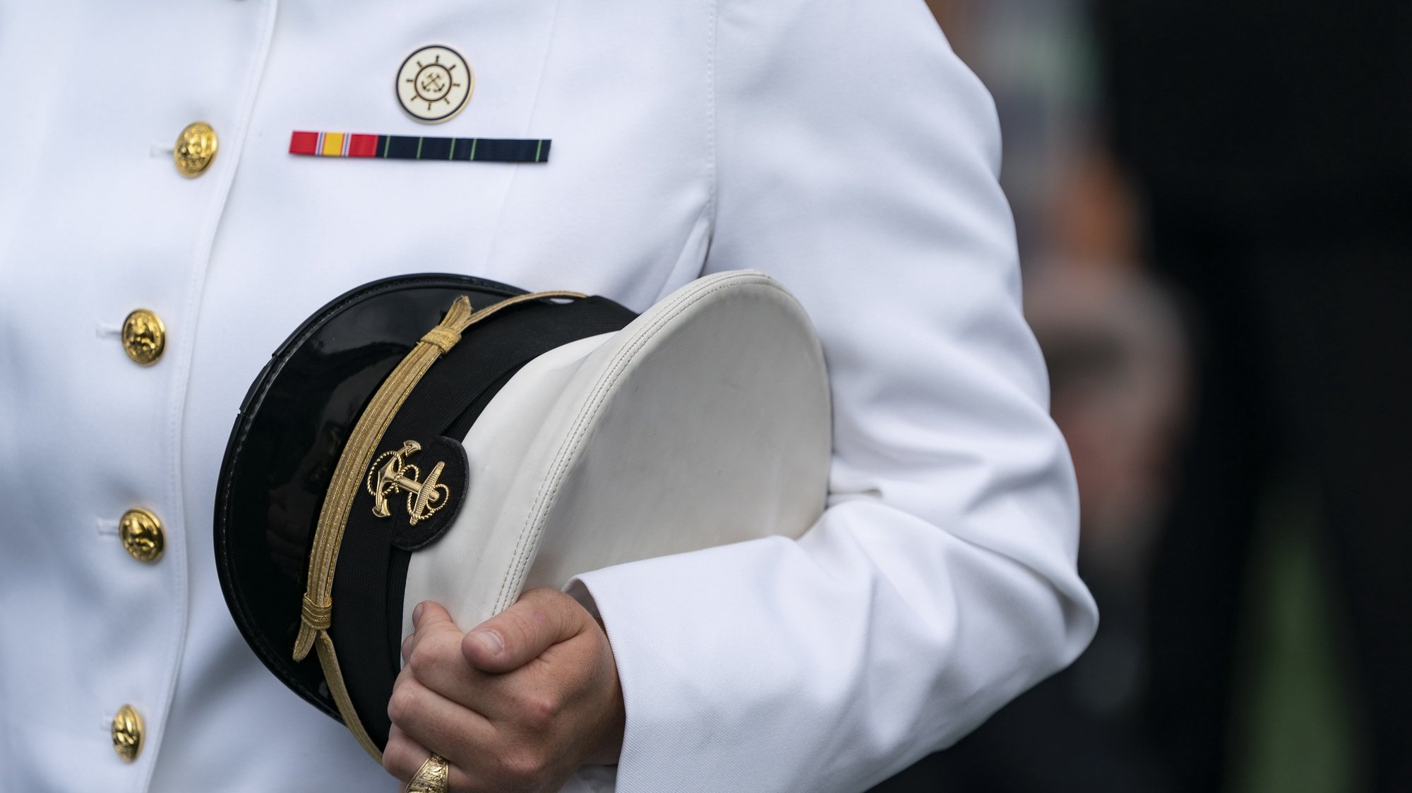 epa09234041 An unidentified Midshipman holds his US Capitol during the United States Naval Academy Class of 2021 graduation and commissioning ceremony held at Navy-Marine Corps Memorial Stadium in Annapolis, Maryland, USA, 28 May 2021.  EPA/Alex Edelman / POOL