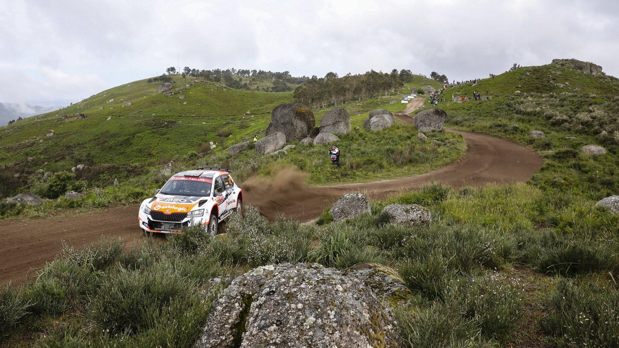 epa09219371 Armindo Araujo of Portugal drives his Skoda Fabia Evo WRC3 during Day 2 of the Rally Portugal 2021 as part of the FIA World Rally Championship (WRC) near Vieira do Minho, Portugal, 22 May 2021.  EPA/JOSE COELHO