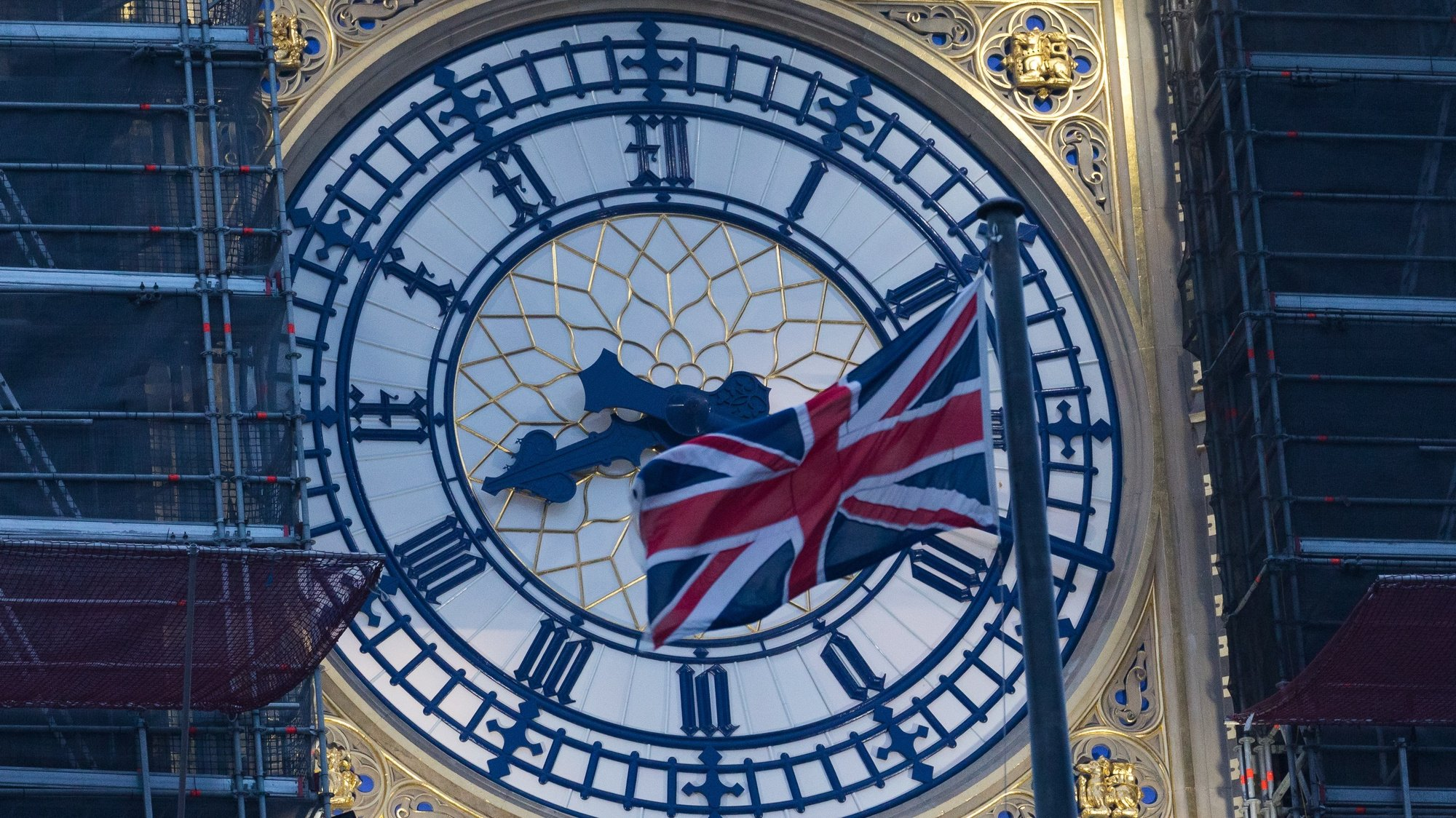 epa08913909 Big Ben clock face with a Union Jack flag seen at dawn in Westminster, London, Britain, 01 January 2021. Britain left the European Union at 11pm on 31 December 2020.  EPA/VICKIE FLORES
