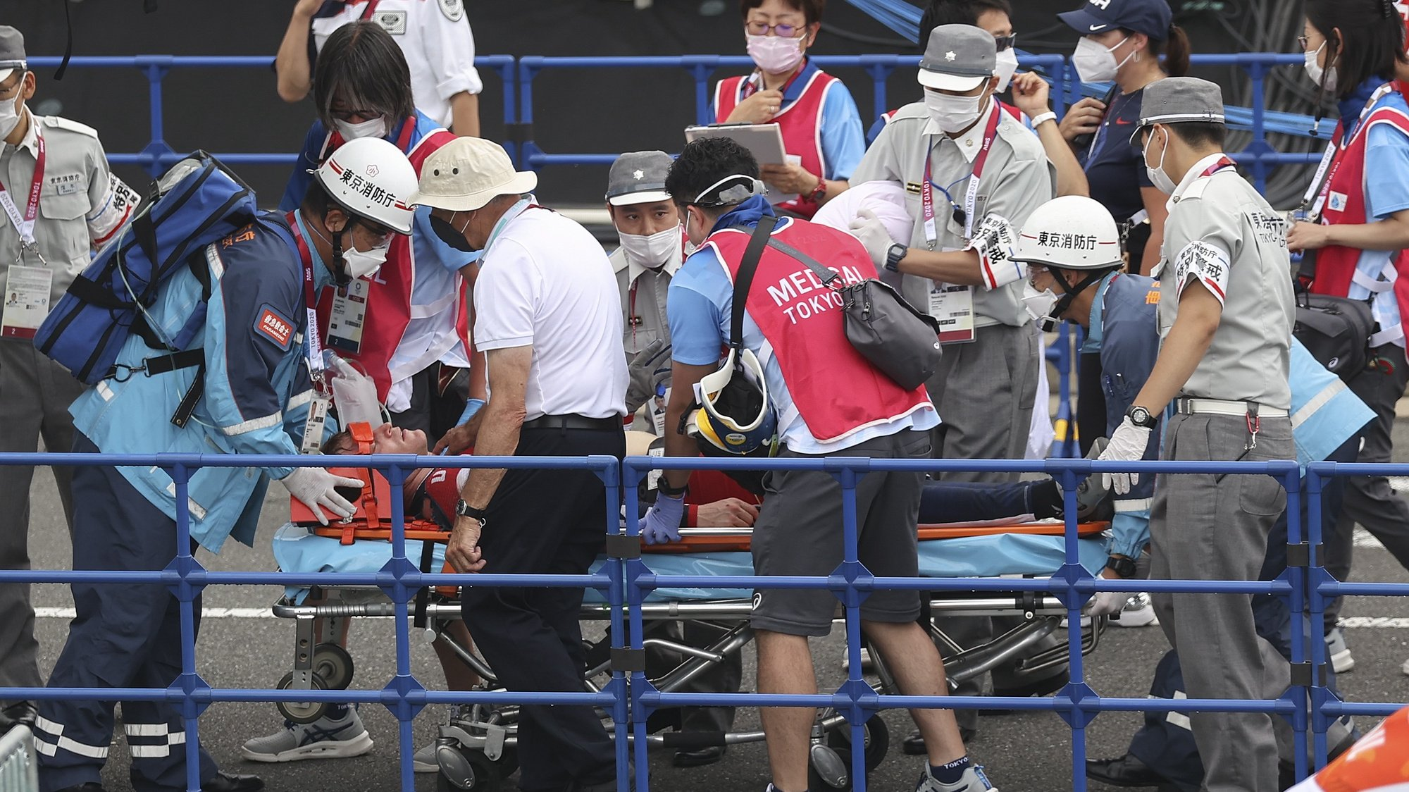 epa09378670 Connor Fields (C) of USA receives medical attention after crashing at the Men's Cycling BMX Racing semifinal during the Cycling BMX Racing events of the Tokyo 2020 Olympic Games at the Ariake Urban Sports Park in Tokyo, Japan, 30 July 2021.  EPA/FAZRY ISMAIL