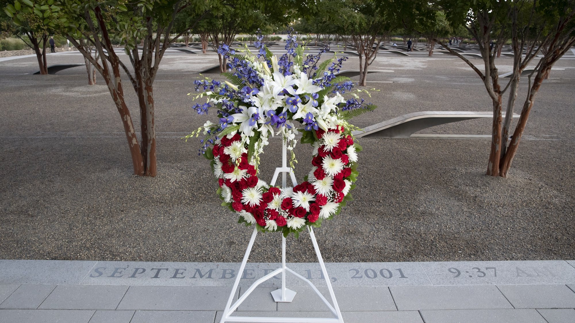 epa09460936 A wreath is placed at the National 9/11 Pentagon Memorial, before an observance ceremony for the 20th anniversary of the 9/11 attacks, at the Pentagon in Arlington, Virginia, USA, 11 September 2021. The 20th anniversary of the worst terrorist attack on US soil is being observed at various locations throughout the world.  EPA/MICHAEL REYNOLDS