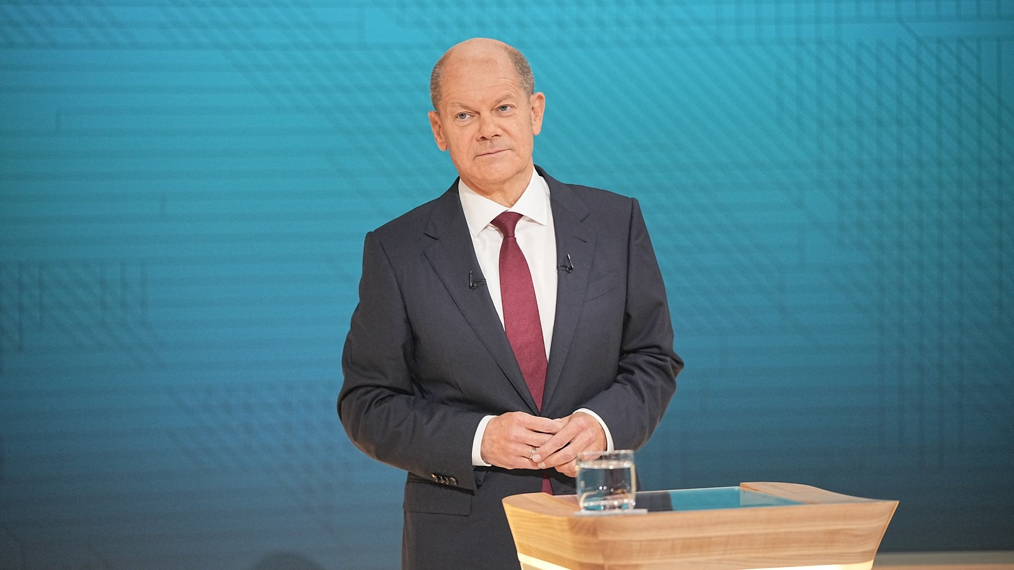 epa09464152 German Minister of Finance and Social Democratic Party (SPD) top candidate for the federal elections Olaf Scholz pictured in the studio during the ARD/ZDF TV station live recording of the TV debate 'The Truel. Three-way fight for the chancellorship' ('Das Triell. Dreikampf ums Kanzleramt') in Berlin, Germany, 12 September 2021. For the second time prior to the general elections on 26 September 2021, the three candidates of Greens, Christian Democrats and Social Democrats, meet in a 'truel', for a live TV debate in the evening of 12 September 2021.  EPA/Michael Kappeler / POOL
