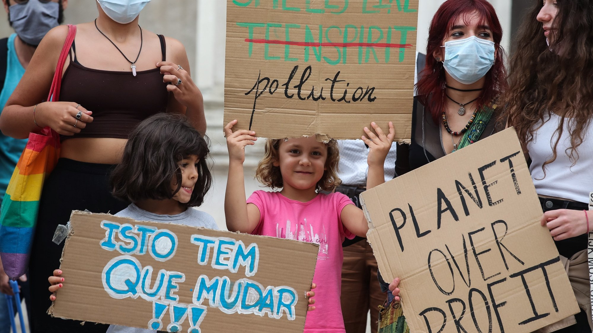 epa09486139 Participants carry placards during a Youth Climate Strike in Coimbra, Portugal, 24 September 2021. The student organisation that emerged in 2019 with Swedish activist Greta Thunberg is back on the streets demanding a just transition under the slogan 'Our house is on fire. Society must act'. This is the 8th demonstration called by Portuguese students in the name of climate justice.  EPA/PAULO NOVAIS