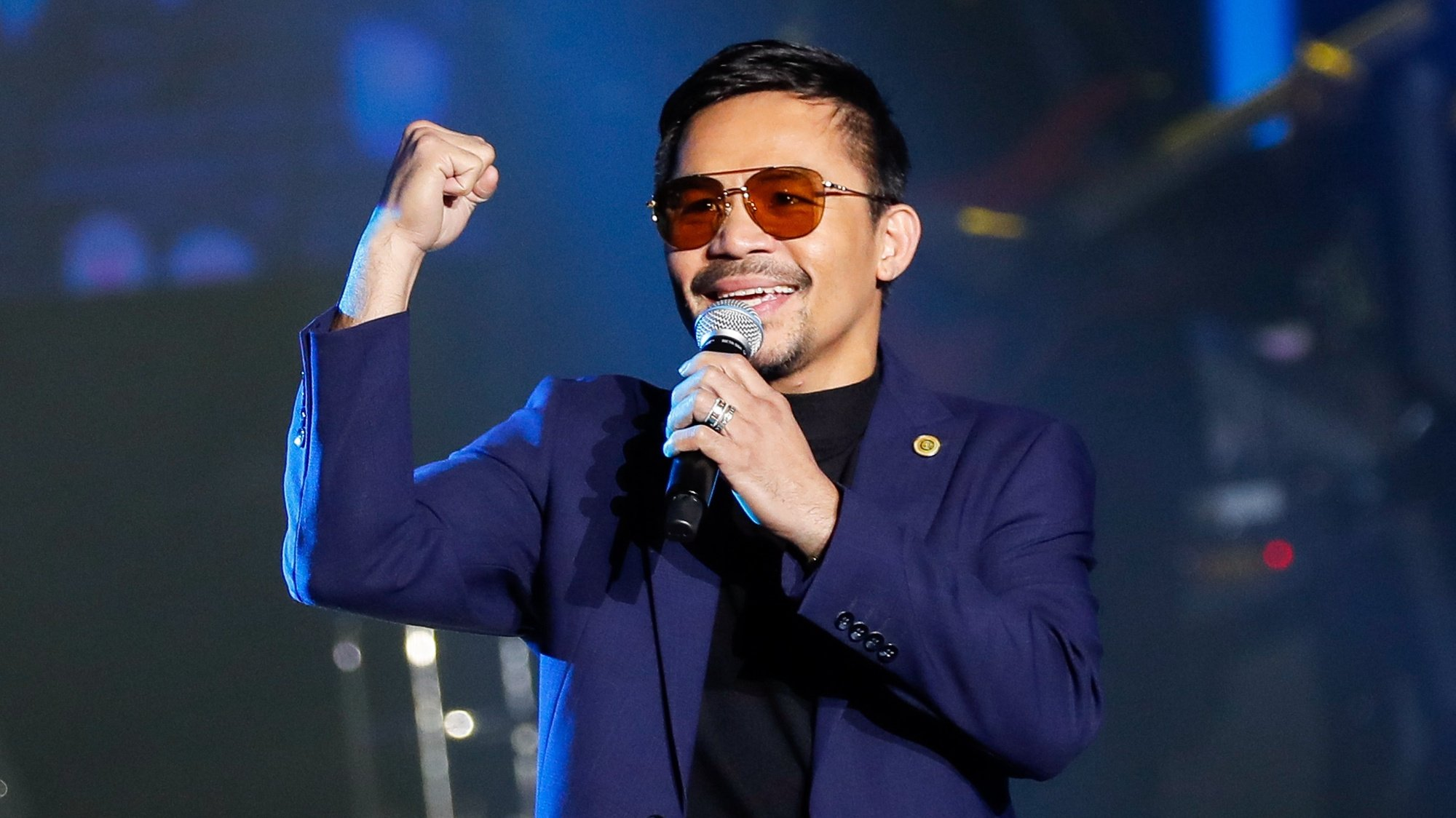 epa09475975 (FILE) - Filipino boxing champion and senator Manny Pacquiao performs during the launch of his own crypto currency in Manila, Philippines 01 September 2019 (reissued 19 September 2021). Pacquiao accepted the nomination of his PDP-Laban party to run for president in 2022, as he said on 19 September 2021.  EPA/MARK R. CRISTINO *** Local Caption *** 55435064