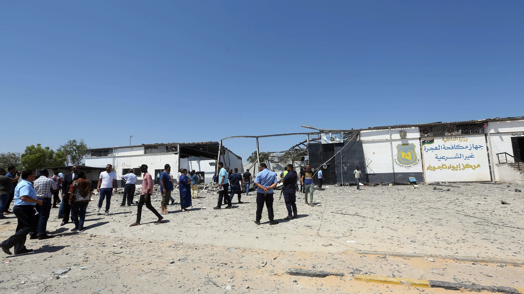 epa07692754 Migrants check the rubble of a destroyed detention center in Tripoli's, Libya, 03 July 2019. according to media reports, At least 44 people killed and 130 were injured after strike hit the Tajoura detention center held at least 600 refugees were attempting to reach Europe from Libya. The parties disputed didn't claimed any responsibility for the attack.  EPA/STR