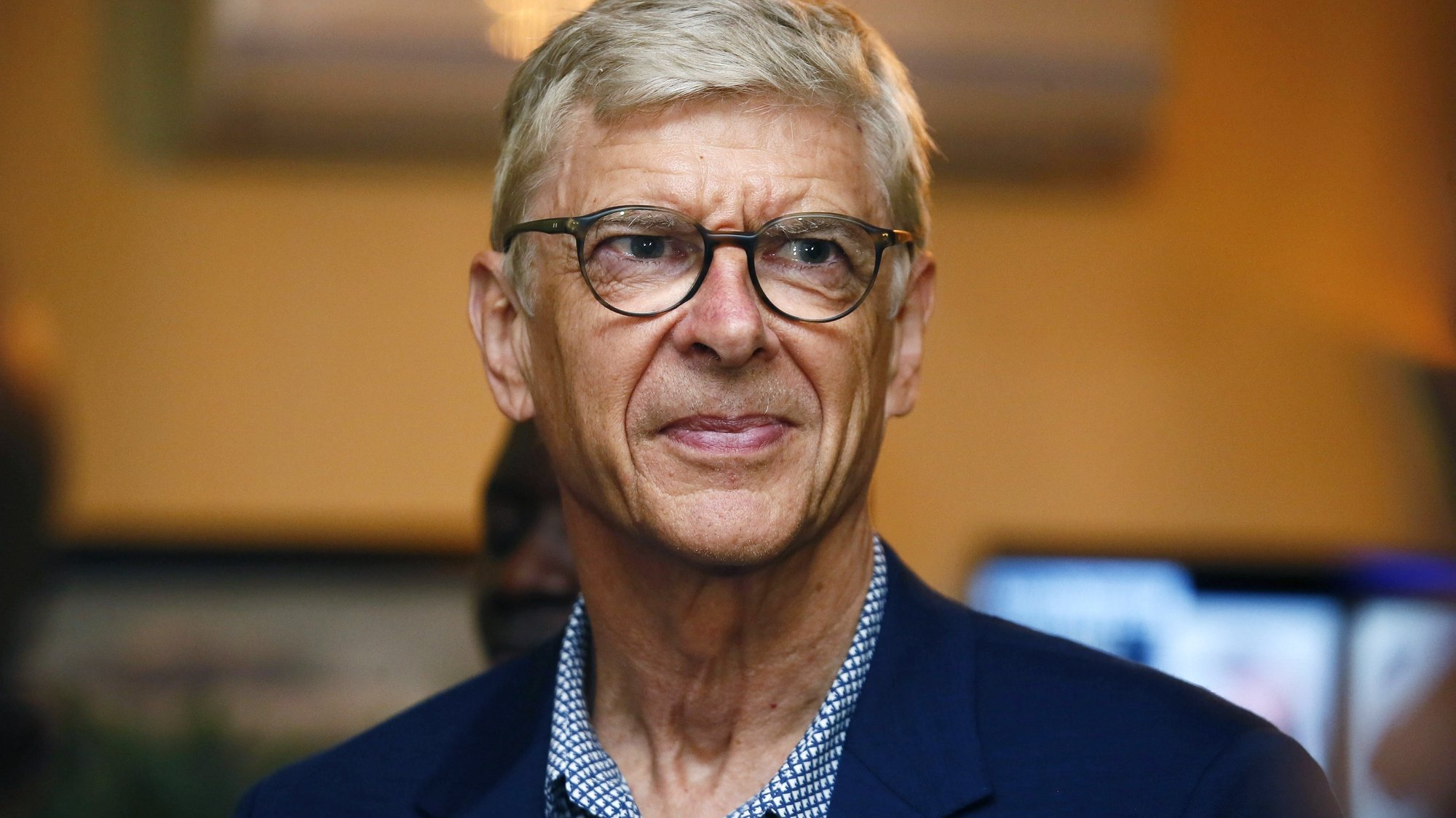 epa06965332 Former soccer coach Arsene Wenger arrives at the Roberts International Airport in Harbel, Liberia, 22 August 2018. Liberian president George Weah is to award his former coach Arsene Wenger his country's highest honour on 23 August 2018.  EPA/AHMED JALLLANZO