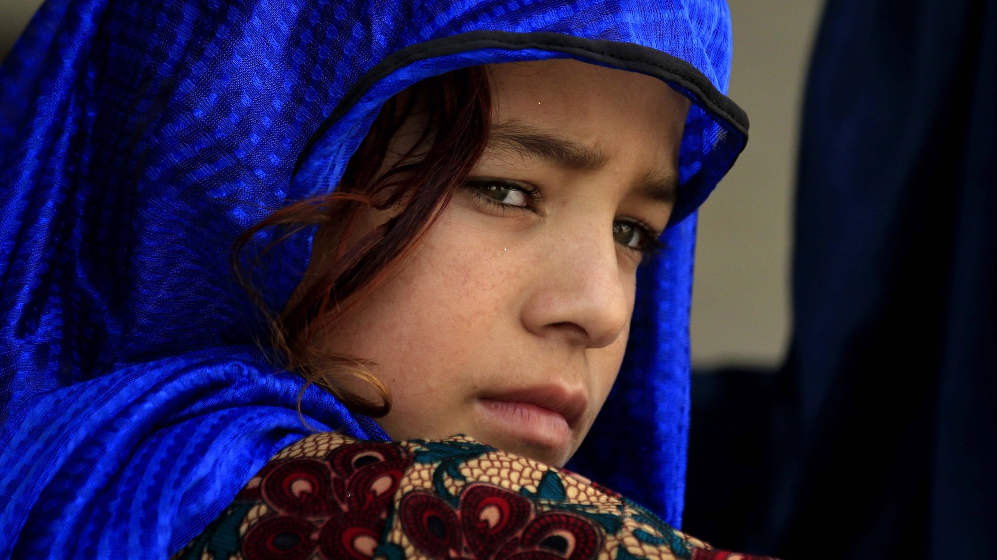 epa07005516 Afghan refugee girl waits to get registered at a United Nation High Commissioner for Refugees (UNHCR) registration center in Azakhel area of Nowshera, Khyber Pakhtunkhwa province, Pakistan, 08 September 2018. Pakistan that hosts more than 1.5 million Afghan refugees has repatriated more than one hundred thousands refugees back to their country under an UNHCR voluntarily return program in the last two years. Others are not identified.  EPA/BILAWAL ARBAB