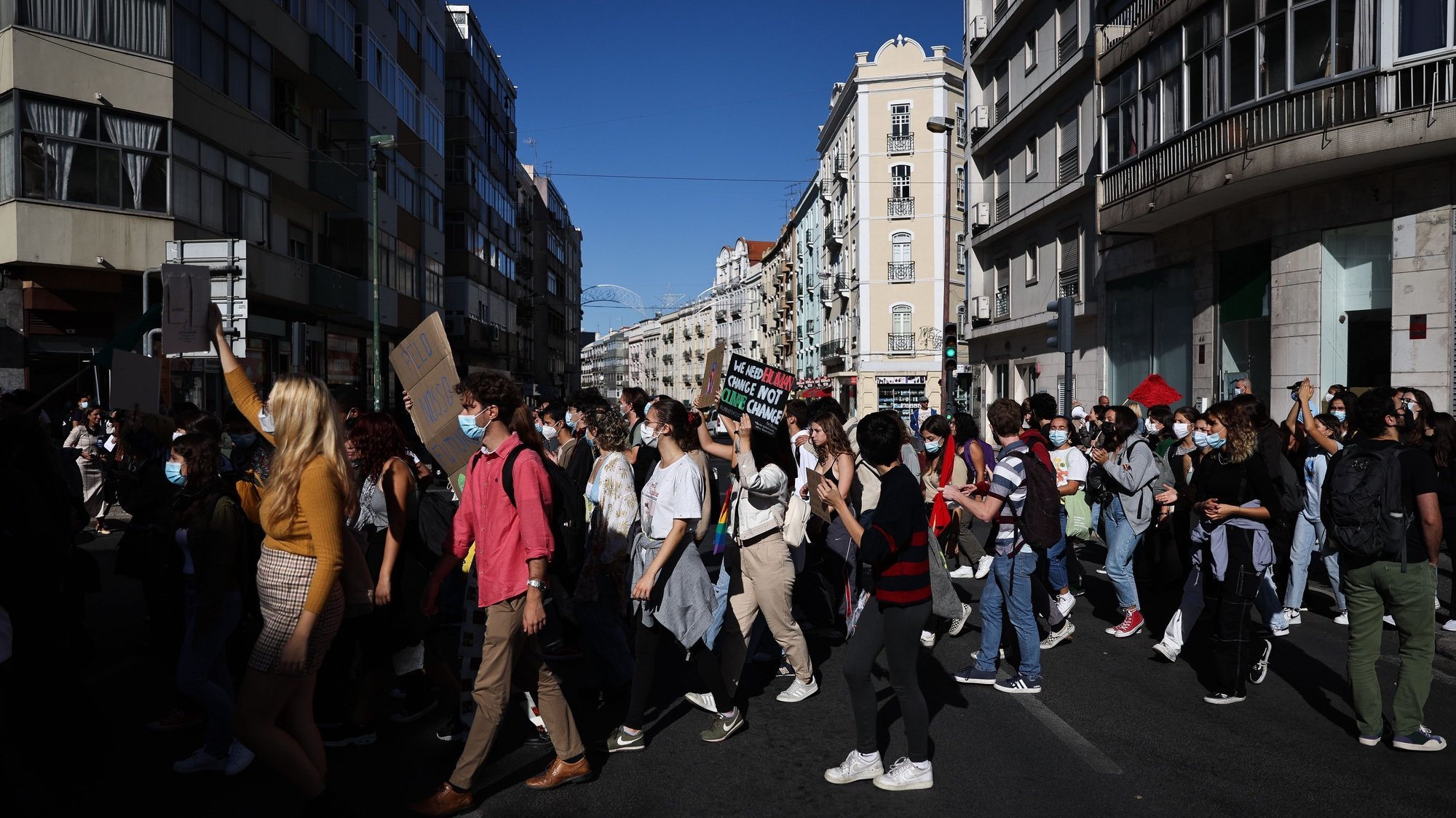Students attend the Global Climate Strike Demonstration to demand fast climate action from world leaders, demanding to include the energy, transport, and agro-forestry sectors and education, mining, and urbanization, in Lisbon, Portugal, 22 October 2021. MARIO CRUZ/LUSA