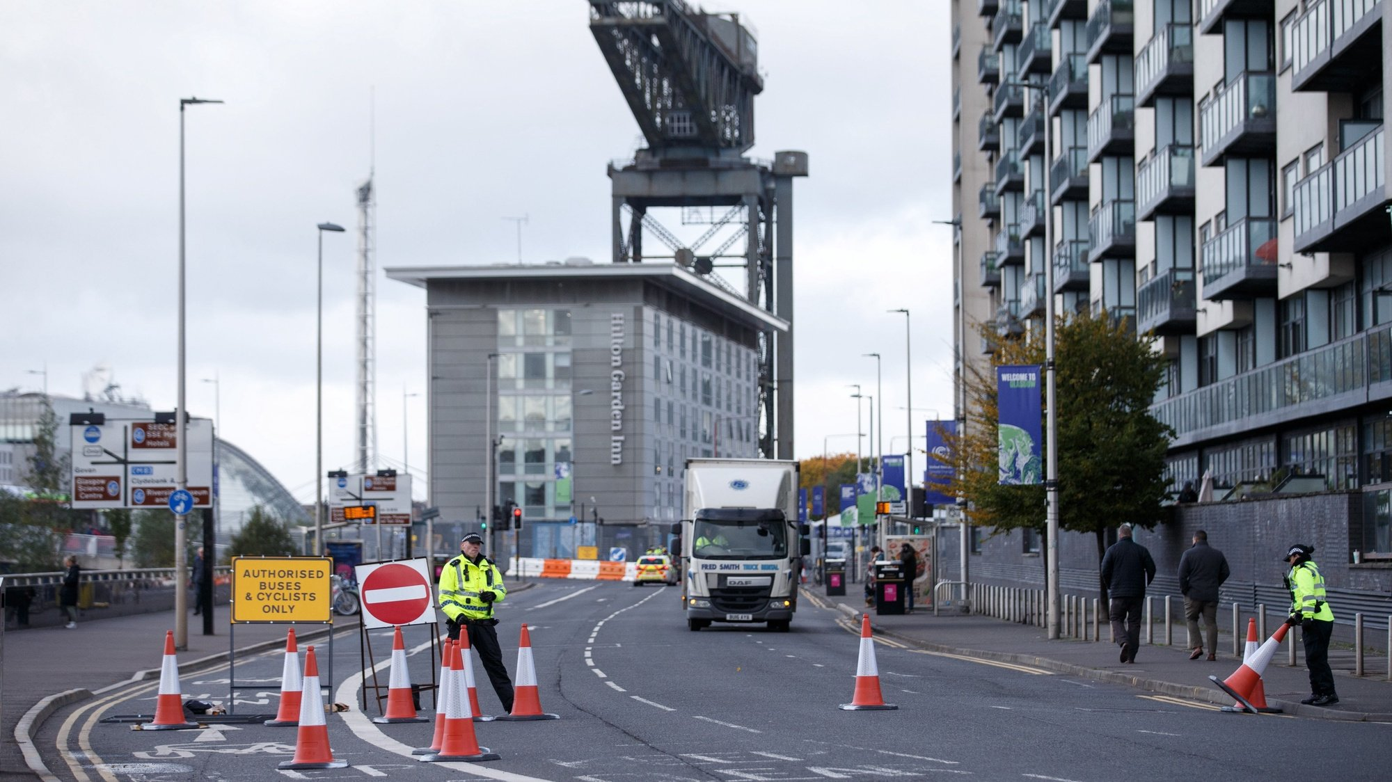 epa09545716 Police closed the roads around the Hydro and the venue for the COP26 in Glasgow, Britain, 25 October 2021. The 2021 United Nations Climate Change Conference, also known as COP26 and as the Glasgow Conference, is the 26th United Nations Climate Change conference. The COP26 summit from 31 October to 12 November 2021 will bring parties together to accelerate action towards the goals of the Paris Agreement and the UN Framework Convention on Climate Change.  EPA/ROBERT PERRY