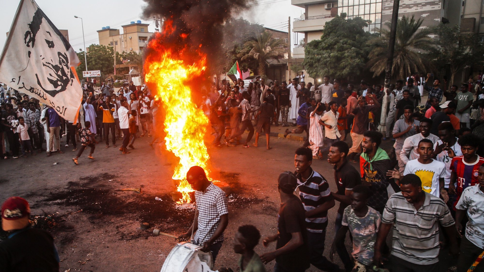 epaselect epa09547395 Sudanese protesters chant slogans next to burning tires during a demonstration in the capital Khartoum, Sudan, 26 October 2021. Protests continued in Sudan on 26 October a day after Sudan's military launched a coup attempt and arrested the Prime Minister Abdalla Hamdok and other senior ministers and civilian members of the Transitional Sovereignty Council during early morning raids. According to the reports seven people were killed and 140 were injured in the country.  EPA/MOHAMMED ABU OBAID