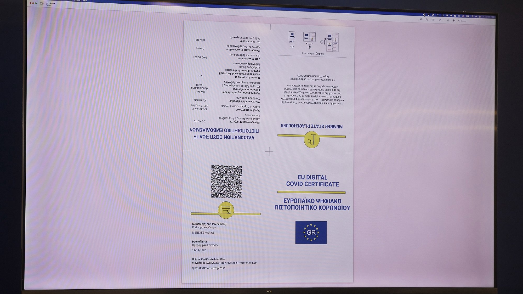 epa09232677 A handout photo made available by the Press Office of the Greek Prime Minister shows a screen displaying the EU Digital COVID Certificate, which will facilitate travelling within the European Union, during its presentation in Athens, Greece, 28 May 2021. 'Greece is ready to activate the digital certificate earlier than 01 July and we encourage other countries to do the same to avoid the complexity of bilateral negotiations', Greek Prime Minister Kyriakos Mitsotakis said while addressing the presentation of the EU Digital Covid Certificate.  EPA/DIMITRIS PAPAMITSOS/GREEK PRIME MINISTER'S PRESS OFFICE HANDOUT  HANDOUT EDITORIAL USE ONLY/NO SALES